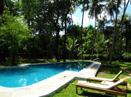 Botanique Goa, guest house in Assagao