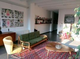 Spacieux et lumineux appartement-loft dans un cadre verdoyant et sympathique