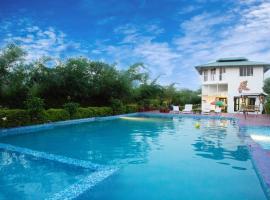 Corbett Treat Resort, room in Rāmnagar