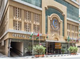 OYO 122 Crystal Plaza Hotel