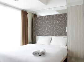Modern 2BR @ Tamansari La Grande Apartment By Travelio