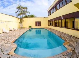 Pousada H Guaruja, hotel in Guarujá