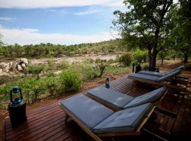 Ivory Wilderness River Rock Lodge