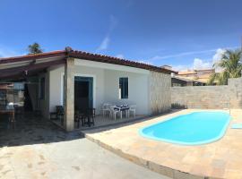 Casa de praia em condomínio fechado com piscina própria