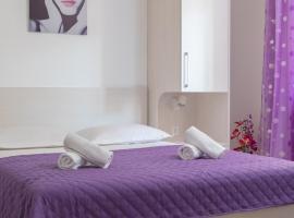 Apartment Sisarić A2, room in Podgora
