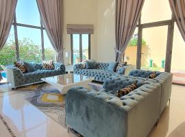 Best Palm Jumeirah Beachfront Villa 5 Bedroom with private pool by Stay Here Holiday Homes, holiday rental in Dubai