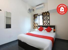 OYO 31016 Sunset Gatehouse, hotel in Mysore