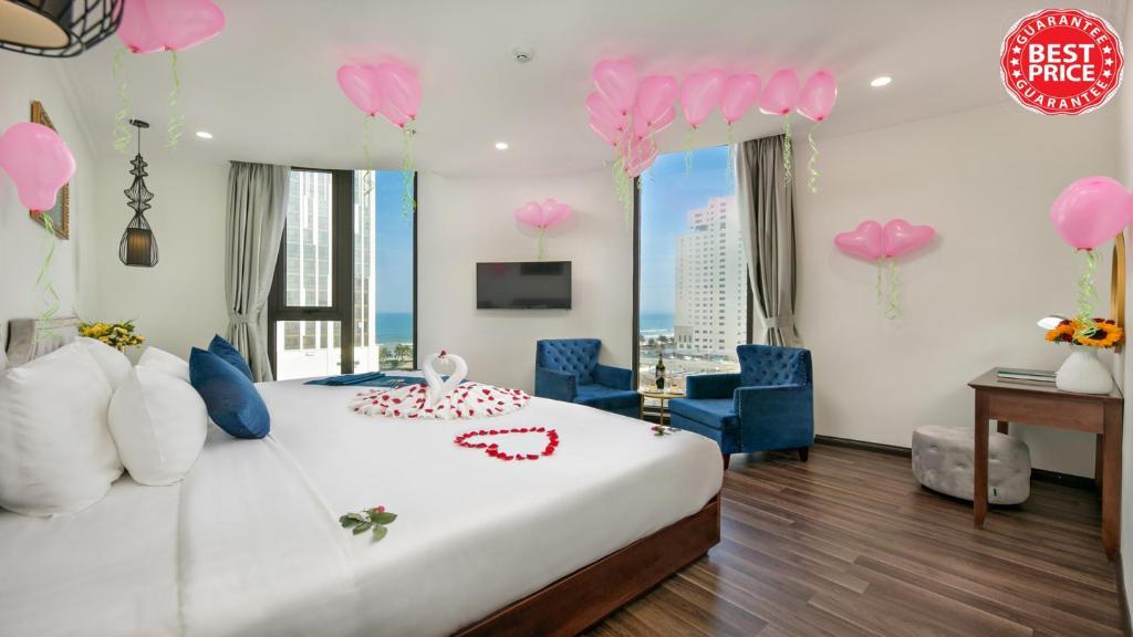 Hình của Suite Giường Đôi/2 Giường Đơn Nhìn Ra Góc Biển #1