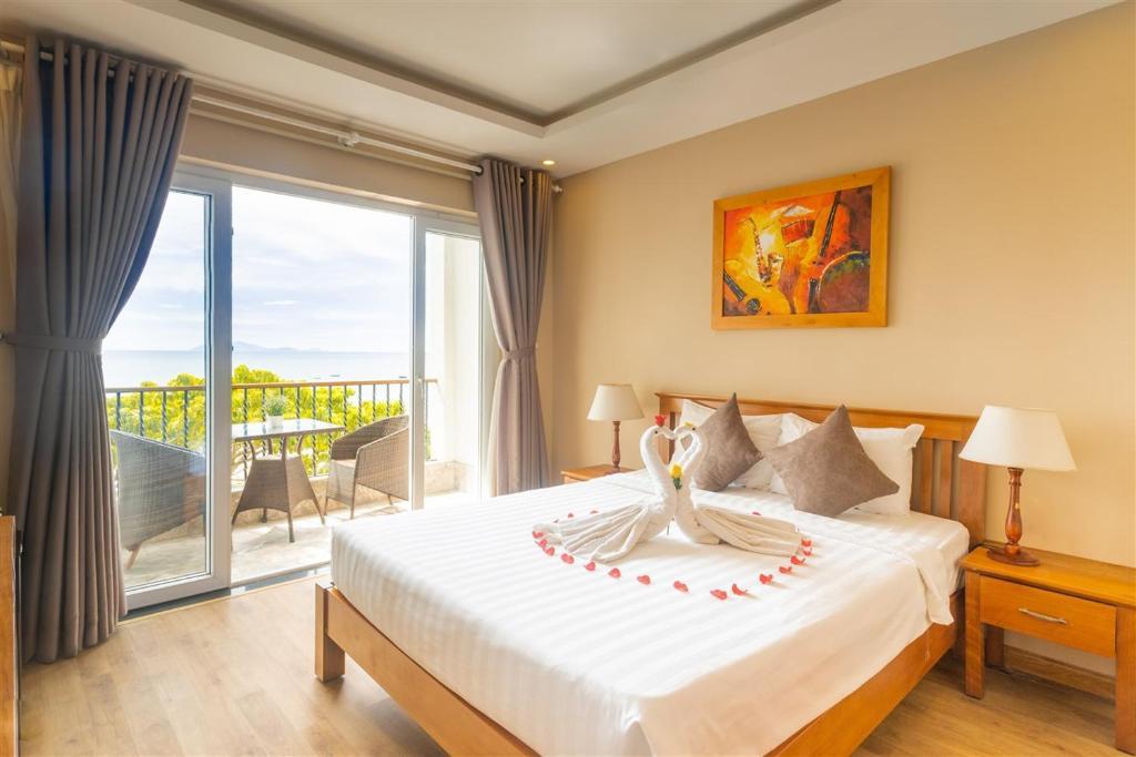 Hình của Phòng Deluxe Giường Đôi Với Ban Công - Nhìn Ra Biển #1