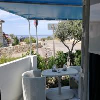 La Perla sardasolemare </h2 </a <div class=sr-card__item sr-card__item--badges <div class= sr-card__badge sr-card__badge--class u-margin:0  data-ga-track=click data-ga-category=SR Card Click data-ga-action=Hotel rating data-ga-label=book_window:  day(s)  <span class=bh-quality-bars bh-quality-bars--small   <svg class=bk-icon -iconset-square_rating fill=#FEBB02 height=12 width=12<use xlink:href=#icon-iconset-square_rating</use</svg<svg class=bk-icon -iconset-square_rating fill=#FEBB02 height=12 width=12<use xlink:href=#icon-iconset-square_rating</use</svg<svg class=bk-icon -iconset-square_rating fill=#FEBB02 height=12 width=12<use xlink:href=#icon-iconset-square_rating</use</svg </span </div   <div class=sr-card__item__review-score style=padding: 8px 0  <div class=bui-review-score c-score bui-review-score--inline bui-review-score--smaller <div class=bui-review-score__badge aria-label=Punteggio di 10 10 </div <div class=bui-review-score__content <div class=bui-review-score__title Eccezionale </div </div </div   </div </div <div class=sr-card__item   data-ga-track=click data-ga-category=SR Card Click data-ga-action=Hotel location data-ga-label=book_window:  day(s)  <svg aria-hidden=true class=bk-icon -iconset-geo_pin sr_svg__card_icon focusable=false height=12 role=presentation width=12<use xlink:href=#icon-iconset-geo_pin</use</svg <div class= sr-card__item__content   La Ciaccia • <span 3,8 km </span  dal centro </div </div <span data-et-view= OLBdJbGNNMMfPESHbfALbLEHFO:1  OLBdJbGNNMMfPESHbfALbLEHFO:2  </span </div </div </div </li <li id=hotel_2800107 data-is-in-favourites=0 data-hotel-id='2800107' class=sr-card sr-card--arrow bui-card bui-u-bleed@small js-sr-card m_sr_info_icons card-halved card-halved--active   <div data-href=/hotel/it/studio-azzurro-r.it.html onclick=window.open(this.getAttribute('data-href')); target=_blank class=sr-card__row bui-card__content data-et-click= data-et-view=  <div class=sr-card__image js-sr_simple_card_hotel_image has-debolded-deal 