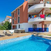 Villa Sv. Petar </h2 </a <div class=sr-card__item sr-card__item--badges <div class= sr-card__badge sr-card__badge--class u-margin:0  data-ga-track=click data-ga-category=SR Card Click data-ga-action=Hotel rating data-ga-label=book_window:  day(s)  <i class= bk-icon-wrapper bk-icon-stars star_track  title=3 stjerner  <svg aria-hidden=true class=bk-icon -sprite-ratings_stars_3 focusable=false height=10 width=32<use xlink:href=#icon-sprite-ratings_stars_3</use</svg                     <span class=invisible_spoken3 stjerner</span </i </div   <div style=padding: 2px 0  <div class=bui-review-score c-score bui-review-score--smaller <div class=bui-review-score__badge aria-label=Har fått 8,9 i score 8,9 </div <div class=bui-review-score__content <div class=bui-review-score__title Utmerket </div </div </div   </div </div <div class=sr-card__item   data-ga-track=click data-ga-category=SR Card Click data-ga-action=Hotel location data-ga-label=book_window:  day(s)  <svg alt=Beliggenhet class=bk-icon -iconset-geo_pin sr_svg__card_icon height=12 width=12<use xlink:href=#icon-iconset-geo_pin</use</svg <div class= sr-card__item__content   Sveti Petar • <span 1,4 km </span  fra sentrum </div </div </div </div </div </li <div data-et-view=cJaQWPWNEQEDSVWe:1</div <li id=hotel_5220849 data-is-in-favourites=0 data-hotel-id='5220849' class=sr-card sr-card--arrow bui-card bui-u-bleed@small js-sr-card m_sr_info_icons card-halved card-halved--active   <div data-href=/hotel/hr/apartmens-4-stars.no.html onclick=window.open(this.getAttribute('data-href')); target=_blank class=sr-card__row bui-card__content data-et-click=  <div class=sr-card__image js-sr_simple_card_hotel_image has-debolded-deal js-lazy-image sr-card__image--lazy data-src=https://r-cf.bstatic.com/xdata/images/hotel/square200/204101195.jpg?k=3aaddcef1ba4124dad8585e2b8cc069da495ed1ccf6448992d55e49620d64e75&o=&s=1,https://q-cf.bstatic.com/xdata/images/hotel/max1024x768/204101195.jpg?k=f56966c09cb27555b79c69b3640723115baff63755616eeb13294a68373ac64c&o=&s=1  <div class=sr-card__image-inner css-loading-hidden </div <noscript <div class=sr-card__image--nojs style=background-image: url('https://r-cf.bstatic.com/xdata/images/hotel/square200/204101195.jpg?k=3aaddcef1ba4124dad8585e2b8cc069da495ed1ccf6448992d55e49620d64e75&o=&s=1')</div </noscript </div <div class=sr-card__details data-et-click=     data-et-view=  <div class=sr-card_details__inner <a href=/hotel/hr/apartmens-4-stars.no.html onclick=event.stopPropagation(); target=_blank <h2 class=sr-card__name u-margin:0 u-padding:0 data-ga-track=click data-ga-category=SR Card Click data-ga-action=Hotel name data-ga-label=book_window:  day(s)  Four Stars Apartments </h2 </a <div class=sr-card__item sr-card__item--badges <div class= sr-card__badge sr-card__badge--class u-margin:0  data-ga-track=click data-ga-category=SR Card Click data-ga-action=Hotel rating data-ga-label=book_window:  day(s)  <i class= bk-icon-wrapper bk-icon-stars star_track  title=4 stjerner  <svg aria-hidden=true class=bk-icon -sprite-ratings_stars_4 focusable=false height=10 width=43<use xlink:href=#icon-sprite-ratings_stars_4</use</svg                     <span class=invisible_spoken4 stjerner</span </i </div   <div style=padding: 2px 0  <div class=bui-review-score c-score bui-review-score--smaller <div class=bui-review-score__badge aria-label=Har fått 9,8 i score 9,8 </div <div class=bui-review-score__content <div class=bui-review-score__title Over all forventning </div </div </div   </div </div <div class=sr-card__item   data-ga-track=click data-ga-category=SR Card Click data-ga-action=Hotel location data-ga-label=book_window:  day(s)  <svg alt=Beliggenhet class=bk-icon -iconset-geo_pin sr_svg__card_icon height=12 width=12<use xlink:href=#icon-iconset-geo_pin</use</svg <div class= sr-card__item__content   Sveti Petar • <span 1,4 km </span  fra sentrum </div </div </div </div </div </li <div data-et-view=cJaQWPWNEQEDSVWe:1</div <li id=hotel_4772966 data-is-in-favourites=0 data-hotel-id='4772966' class=sr-card sr-card--arrow bui-card bui-u-bleed@small js-sr-card m_sr_info_icons card-halved card-halved--active   <div data-href=/hotel/hr/house-roko-sveti-petar-na-moru.no.html onclick=window.open(this.getAttribute('data-href')); target=_blank class=sr-card__row bui-card__content data-et-click=  <div class=sr-card__image js-sr_simple_card_hotel_image has-debolded-deal js-lazy-image sr-card__image--lazy data-src=https://r-cf.bstatic.com/xdata/images/hotel/square200/196923646.jpg?k=2f5122aaffdddafc079762428c7cdf3a54ce6639e12ffe960e5a2dc051a38941&o=&s=1,https://q-cf.bstatic.com/xdata/images/hotel/max1024x768/196923646.jpg?k=30e258a8a510d8d68049b16a922e9b6b4faff83e83821dad8081ec54dd1c9107&o=&s=1  <div class=sr-card__image-inner css-loading-hidden </div <noscript <div class=sr-card__image--nojs style=background-image: url('https://r-cf.bstatic.com/xdata/images/hotel/square200/196923646.jpg?k=2f5122aaffdddafc079762428c7cdf3a54ce6639e12ffe960e5a2dc051a38941&o=&s=1')</div </noscript </div <div class=sr-card__details data-et-click=     data-et-view=  <div class=sr-card_details__inner <a href=/hotel/hr/house-roko-sveti-petar-na-moru.no.html onclick=event.stopPropagation(); target=_blank <h2 class=sr-card__name u-margin:0 u-padding:0 data-ga-track=click data-ga-category=SR Card Click data-ga-action=Hotel name data-ga-label=book_window:  day(s)  House Roko </h2 </a <div class=sr-card__item sr-card__item--badges <div style=padding: 2px 0  <div class=bui-review-score c-score bui-review-score--smaller <div class=bui-review-score__badge aria-label=Har fått 8,8 i score 8,8 </div <div class=bui-review-score__content <div class=bui-review-score__title Utmerket </div </div </div   </div </div <div class=sr-card__item   data-ga-track=click data-ga-category=SR Card Click data-ga-action=Hotel location data-ga-label=book_window:  day(s)  <svg alt=Beliggenhet class=bk-icon -iconset-geo_pin sr_svg__card_icon height=12 width=12<use xlink:href=#icon-iconset-geo_pin</use</svg <div class= sr-card__item__content   Sveti Petar • <span 150 m </span  fra sentrum </div </div </div </div </div </li <div data-et-view=cJaQWPWNEQEDSVWe:1</div <li id=hotel_1236216 data-is-in-favourites=0 data-hotel-id='1236216' class=sr-card sr-card--arrow bui-card bui-u-bleed@small js-sr-card m_sr_info_icons card-halved card-halved--active   <div data-href=/hotel/hr/holiday-home-podvrsje-16a.no.html onclick=window.open(this.getAttribute('data-href')); target=_blank class=sr-card__row bui-card__content data-et-click=  <div class=sr-card__image js-sr_simple_card_hotel_image has-debolded-deal js-lazy-image sr-card__image--lazy data-src=https://q-cf.bstatic.com/xdata/images/hotel/square200/200214435.jpg?k=5209b3b2883cb21154637e60343dd2fe03079cc303ac668ca549d0eabeafc77f&o=&s=1,https://q-cf.bstatic.com/xdata/images/hotel/max1024x768/200214435.jpg?k=3c3c05b49c335e95e2c9605bae89cd025565f30b6259caf790da5c45554c2658&o=&s=1  <div class=sr-card__image-inner css-loading-hidden </div <noscript <div class=sr-card__image--nojs style=background-image: url('https://q-cf.bstatic.com/xdata/images/hotel/square200/200214435.jpg?k=5209b3b2883cb21154637e60343dd2fe03079cc303ac668ca549d0eabeafc77f&o=&s=1')</div </noscript </div <div class=sr-card__details data-et-click=     data-et-view=  <div class=sr-card_details__inner <a href=/hotel/hr/holiday-home-podvrsje-16a.no.html onclick=event.stopPropagation(); target=_blank <h2 class=sr-card__name u-margin:0 u-padding:0 data-ga-track=click data-ga-category=SR Card Click data-ga-action=Hotel name data-ga-label=book_window:  day(s)  Holiday Home Dvori Dida Mile </h2 </a <div class=sr-card__item sr-card__item--badges <div class= sr-card__badge sr-card__badge--class u-margin:0  data-ga-track=click data-ga-category=SR Card Click data-ga-action=Hotel rating data-ga-label=book_window:  day(s)  <i class= bk-icon-wrapper bk-icon-stars star_track  title=4 stjerner  <svg aria-hidden=true class=bk-icon -sprite-ratings_stars_4 focusable=false height=10 width=43<use xlink:href=#icon-sprite-ratings_stars_4</use</svg                     <span class=invisible_spoken4 stjerner</span </i </div   <div style=padding: 2px 0  <div class=bui-review-score c-score bui-review-score--smaller <div class=bui-review-score__badge aria-label=Har fått 10 i score 10 </div <div class=bui-review-score__content <div class=bui-review-score__title Over all forventning </div </div </div   </div </div <div class=sr-card__item   data-ga-track=click data-ga-category=SR Card Click data-ga-action=Hotel location data-ga-label=book_window:  day(s)  <svg alt=Beliggenhet class=bk-icon -iconset-geo_pin sr_svg__card_icon height=12 width=12<use xlink:href=#icon-iconset-geo_pin</use</svg <div class= sr-card__item__content   Sveti Petar • <span 2,7 km </span  fra sentrum </div </div </div </div </div </li <div data-et-view=cJaQWPWNEQEDSVWe:1</div <li id=hotel_1738339 data-is-in-favourites=0 data-hotel-id='1738339' class=sr-card sr-card--arrow bui-card bui-u-bleed@small js-sr-card m_sr_info_icons card-halved card-halved--active   <div data-href=/hotel/hr/mobile-homes-tino-amp-ivano.no.html onclick=window.open(this.getAttribute('data-href')); target=_blank class=sr-card__row bui-card__content data-et-click=  <div class=sr-card__image js-sr_simple_card_hotel_image has-debolded-deal js-lazy-image sr-card__image--lazy data-src=https://q-cf.bstatic.com/xdata/images/hotel/square200/69194162.jpg?k=ee04bf478dc021b6a74027aa318db511f992210db63baf08e2aa4a7b89d5b196&o=&s=1,https://r-cf.bstatic.com/xdata/images/hotel/max1024x768/69194162.jpg?k=30538b656356e7050dd75852f634f85eb5bd3d3a91761185031ba5f0fbd0da91&o=&s=1  <div class=sr-card__image-inner css-loading-hidden </div <noscript <div class=sr-card__image--nojs style=background-image: url('https://q-cf.bstatic.com/xdata/images/hotel/square200/69194162.jpg?k=ee04bf478dc021b6a74027aa318db511f992210db63baf08e2aa4a7b89d5b196&o=&s=1')</div </noscript </div <div class=sr-card__details data-et-click=     data-et-view=  <div class=sr-card_details__inner <a href=/hotel/hr/mobile-homes-tino-amp-ivano.no.html onclick=event.stopPropagation(); target=_blank <h2 class=sr-card__name u-margin:0 u-padding:0 data-ga-track=click data-ga-category=SR Card Click data-ga-action=Hotel name data-ga-label=book_window:  day(s)  Mobile Homes Tino & Ivano </h2 </a <div class=sr-card__item sr-card__item--badges <div class= sr-card__badge sr-card__badge--class u-margin:0  data-ga-track=click data-ga-category=SR Card Click data-ga-action=Hotel rating data-ga-label=book_window:  day(s)  <i class= bk-icon-wrapper bk-icon-stars star_track  title=3 stjerner  <svg aria-hidden=true class=bk-icon -sprite-ratings_stars_3 focusable=false height=10 width=32<use xlink:href=#icon-sprite-ratings_stars_3</use</svg                     <span class=invisible_spoken3 stjerner</span </i </div   <div style=padding: 2px 0  <div class=bui-review-score c-score bui-review-score--smaller <div class=bui-review-score__badge aria-label=Har fått 8,4 i score 8,4 </div <div class=bui-review-score__content <div class=bui-review-score__title Meget bra </div </div </div   </div </div <div class=sr-card__item   data-ga-track=click data-ga-category=SR Card Click data-ga-action=Hotel location data-ga-label=book_window:  day(s)  <svg alt=Beliggenhet class=bk-icon -iconset-geo_pin sr_svg__card_icon height=12 width=12<use xlink:href=#icon-iconset-geo_pin</use</svg <div class= sr-card__item__content   Sveti Petar • <span 850 m </span  fra sentrum </div </div </div </div </div </li <div data-et-view=cJaQWPWNEQEDSVWe:1</div <li id=hotel_3786525 data-is-in-favourites=0 data-hotel-id='3786525' class=sr-card sr-card--arrow bui-card bui-u-bleed@small js-sr-card m_sr_info_icons card-halved card-halved--active   <div data-href=/hotel/hr/mali-raj-zadar1.no.html onclick=window.open(this.getAttribute('data-href')); target=_blank class=sr-card__row bui-card__content data-et-click=  <div class=sr-card__image js-sr_simple_card_hotel_image has-debolded-deal js-lazy-image sr-card__image--lazy data-src=https://q-cf.bstatic.com/xdata/images/hotel/square200/152596172.jpg?k=1ef62df04a08c690e86d4d26ad73153251e1d87c39478fe5d918554cb5a62818&o=&s=1,https://r-cf.bstatic.com/xdata/images/hotel/max1024x768/152596172.jpg?k=526ecc5cb6928110999b2438dfe6d2cdcd003002f6b06556a897fbbe7f765d76&o=&s=1  <div class=sr-card__image-inner css-loading-hidden </div <noscript <div class=sr-card__image--nojs style=background-image: url('https://q-cf.bstatic.com/xdata/images/hotel/square200/152596172.jpg?k=1ef62df04a08c690e86d4d26ad73153251e1d87c39478fe5d918554cb5a62818&o=&s=1')</div </noscript </div <div class=sr-card__details data-et-click=     data-et-view=  <div class=sr-card_details__inner <a href=/hotel/hr/mali-raj-zadar1.no.html onclick=event.stopPropagation(); target=_blank <h2 class=sr-card__name u-margin:0 u-padding:0 data-ga-track=click data-ga-category=SR Card Click data-ga-action=Hotel name data-ga-label=book_window:  day(s)  Mali Raj </h2 </a <div class=sr-card__item sr-card__item--badges <div class= sr-card__badge sr-card__badge--class u-margin:0  data-ga-track=click data-ga-category=SR Card Click data-ga-action=Hotel rating data-ga-label=book_window:  day(s)  <i class= bk-icon-wrapper bk-icon-stars star_track  title=3 stjerner  <svg aria-hidden=true class=bk-icon -sprite-ratings_stars_3 focusable=false height=10 width=32<use xlink:href=#icon-sprite-ratings_stars_3</use</svg                     <span class=invisible_spoken3 stjerner</span </i </div   <div style=padding: 2px 0  <div class=bui-review-score c-score bui-review-score--smaller <div class=bui-review-score__badge aria-label=Har fått 9,4 i score 9,4 </div <div class=bui-review-score__content <div class=bui-review-score__title Fantastisk </div </div </div   </div </div <div class=sr-card__item   data-ga-track=click data-ga-category=SR Card Click data-ga-action=Hotel location data-ga-label=book_window:  day(s)  <svg alt=Beliggenhet class=bk-icon -iconset-geo_pin sr_svg__card_icon height=12 width=12<use xlink:href=#icon-iconset-geo_pin</use</svg <div class= sr-card__item__content   Sveti Petar • <span 2,8 km </span  fra sentrum </div </div </div </div </div </li <div data-et-view=cJaQWPWNEQEDSVWe:1</div <li id=hotel_1784477 data-is-in-favourites=0 data-hotel-id='1784477' class=sr-card sr-card--arrow bui-card bui-u-bleed@small js-sr-card m_sr_info_icons card-halved card-halved--active   <div data-href=/hotel/hr/gale-vila.no.html onclick=window.open(this.getAttribute('data-href')); target=_blank class=sr-card__row bui-card__content data-et-click=  <div class=sr-card__image js-sr_simple_card_hotel_image has-debolded-deal js-lazy-image sr-card__image--lazy data-src=https://r-cf.bstatic.com/xdata/images/hotel/square200/69043096.jpg?k=72d217568d00f152134fb3efc07d5954721bad292b72fec5dc2c694be782cbd2&o=&s=1,https://q-cf.bstatic.com/xdata/images/hotel/max1024x768/69043096.jpg?k=635ae8404d3bc504024dd3f0e0cdb29f56d7bb7177d5f7e68eb8e8065854eb50&o=&s=1  <div class=sr-card__image-inner css-loading-hidden </div <noscript <div class=sr-card__image--nojs style=background-image: url('https://r-cf.bstatic.com/xdata/images/hotel/square200/69043096.jpg?k=72d217568d00f152134fb3efc07d5954721bad292b72fec5dc2c694be782cbd2&o=&s=1')</div </noscript </div <div class=sr-card__details data-et-click=     data-et-view=  <div class=sr-card_details__inner <a href=/hotel/hr/gale-vila.no.html onclick=event.stopPropagation(); target=_blank <h2 class=sr-card__name u-margin:0 u-padding:0 data-ga-track=click data-ga-category=SR Card Click data-ga-action=Hotel name data-ga-label=book_window:  day(s)  Gale Vila </h2 </a <div class=sr-card__item sr-card__item--badges <div class= sr-card__badge sr-card__badge--class u-margin:0  data-ga-track=click data-ga-category=SR Card Click data-ga-action=Hotel rating data-ga-label=book_window:  day(s)  <i class= bk-icon-wrapper bk-icon-stars star_track  title=3 stjerner  <svg aria-hidden=true class=bk-icon -sprite-ratings_stars_3 focusable=false height=10 width=32<use xlink:href=#icon-sprite-ratings_stars_3</use</svg                     <span class=invisible_spoken3 stjerner</span </i </div   <div style=padding: 2px 0  <div class=bui-review-score c-score bui-review-score--smaller <div class=bui-review-score__badge aria-label=Har fått 8,5 i score 8,5 </div <div class=bui-review-score__content <div class=bui-review-score__title Meget bra </div </div </div   </div </div <div class=sr-card__item   data-ga-track=click data-ga-category=SR Card Click data-ga-action=Hotel location data-ga-label=book_window:  day(s)  <svg alt=Beliggenhet class=bk-icon -iconset-geo_pin sr_svg__card_icon height=12 width=12<use xlink:href=#icon-iconset-geo_pin</use</svg <div class= sr-card__item__content   Sveti Petar • <span 2,8 km </span  fra sentrum </div </div </div </div </div </li <div data-et-view=cJaQWPWNEQEDSVWe:1</div <li id=hotel_2201841 data-is-in-favourites=0 data-hotel-id='2201841' class=sr-card sr-card--arrow bui-card bui-u-bleed@small js-sr-card m_sr_info_icons card-halved card-halved--active   <div data-href=/hotel/hr/apartmani-san-pedro.no.html onclick=window.open(this.getAttribute('data-href')); target=_blank class=sr-card__row bui-card__content data-et-click=  <div class=sr-card__image js-sr_simple_card_hotel_image has-debolded-deal js-lazy-image sr-card__image--lazy data-src=https://q-cf.bstatic.com/xdata/images/hotel/square200/90156590.jpg?k=592fbdba9337990ef506b8599afbfc97b677e77b245de1cfa8f9439f9177a739&o=&s=1,https://q-cf.bstatic.com/xdata/images/hotel/max1024x768/90156590.jpg?k=5fddef69117cefa982f5881afdf0cb360cc7950f223e156b0e2603deb2c351fb&o=&s=1  <div class=sr-card__image-inner css-loading-hidden </div <noscript <div class=sr-card__image--nojs style=background-image: url('https://q-cf.bstatic.com/xdata/images/hotel/square200/90156590.jpg?k=592fbdba9337990ef506b8599afbfc97b677e77b245de1cfa8f9439f9177a739&o=&s=1')</div </noscript </div <div class=sr-card__details data-et-click=     data-et-view=  <div class=sr-card_details__inner <a href=/hotel/hr/apartmani-san-pedro.no.html onclick=event.stopPropagation(); target=_blank <h2 class=sr-card__name u-margin:0 u-padding:0 data-ga-track=click data-ga-category=SR Card Click data-ga-action=Hotel name data-ga-label=book_window:  day(s)  Apartmani San Pedro </h2 </a <div class=sr-card__item sr-card__item--badges <div class= sr-card__badge sr-card__badge--class u-margin:0  data-ga-track=click data-ga-category=SR Card Click data-ga-action=Hotel rating data-ga-label=book_window:  day(s)  <i class= bk-icon-wrapper bk-icon-stars star_track  title=3 stjerner  <svg aria-hidden=true class=bk-icon -sprite-ratings_stars_3 focusable=false height=10 width=32<use xlink:href=#icon-sprite-ratings_stars_3</use</svg                     <span class=invisible_spoken3 stjerner</span </i </div   <div style=padding: 2px 0  <div class=bui-review-score c-score bui-review-score--smaller <div class=bui-review-score__badge aria-label=Har fått 9,1 i score 9,1 </div <div class=bui-review-score__content <div class=bui-review-score__title Fantastisk </div </div </div   </div </div <div class=sr-card__item   data-ga-track=click data-ga-category=SR Card Click data-ga-action=Hotel location data-ga-label=book_window:  day(s)  <svg alt=Beliggenhet class=bk-icon -iconset-geo_pin sr_svg__card_icon height=12 width=12<use xlink:href=#icon-iconset-geo_pin</use</svg <div class= sr-card__item__content   Sveti Petar • <span 400 m </span  fra sentrum </div </div </div </div </div </li <div data-et-view=cJaQWPWNEQEDSVWe:1</div <li id=hotel_1091753 data-is-in-favourites=0 data-hotel-id='1091753' class=sr-card sr-card--arrow bui-card bui-u-bleed@small js-sr-card m_sr_info_icons card-halved card-halved--active   <div data-href=/hotel/hr/apartments-cirjak.no.html onclick=window.open(this.getAttribute('data-href')); target=_blank class=sr-card__row bui-card__content data-et-click=  <div class=sr-card__image js-sr_simple_card_hotel_image has-debolded-deal js-lazy-image sr-card__image--lazy data-src=https://r-cf.bstatic.com/xdata/images/hotel/square200/53804475.jpg?k=7cbe48f9f059fac367baed484a802de971266466dd13b4715b8b2265759552af&o=&s=1,https://r-cf.bstatic.com/xdata/images/hotel/max1024x768/53804475.jpg?k=4e142e26bf64bfb87715f7b471b7eab86d574334f2bac57e820ca462b448e7b7&o=&s=1  <div class=sr-card__image-inner css-loading-hidden </div <noscript <div class=sr-card__image--nojs style=background-image: url('https://r-cf.bstatic.com/xdata/images/hotel/square200/53804475.jpg?k=7cbe48f9f059fac367baed484a802de971266466dd13b4715b8b2265759552af&o=&s=1')</div </noscript </div <div class=sr-card__details data-et-click=     data-et-view=  <div class=sr-card_details__inner <a href=/hotel/hr/apartments-cirjak.no.html onclick=event.stopPropagation(); target=_blank <h2 class=sr-card__name u-margin:0 u-padding:0 data-ga-track=click data-ga-category=SR Card Click data-ga-action=Hotel name data-ga-label=book_window:  day(s)  Apartments Cirjak </h2 </a <div class=sr-card__item sr-card__item--badges <div class= sr-card__badge sr-card__badge--class u-margin:0  data-ga-track=click data-ga-category=SR Card Click data-ga-action=Hotel rating data-ga-label=book_window:  day(s)  <i class= bk-icon-wrapper bk-icon-stars star_track  title=3 stjerner  <svg aria-hidden=true class=bk-icon -sprite-ratings_stars_3 focusable=false height=10 width=32<use xlink:href=#icon-sprite-ratings_stars_3</use</svg                     <span class=invisible_spoken3 stjerner</span </i </div   <div style=padding: 2px 0  <div class=bui-review-score c-score bui-review-score--smaller <div class=bui-review-score__badge aria-label=Har fått 9,5 i score 9,5 </div <div class=bui-review-score__content <div class=bui-review-score__title Over all forventning </div </div </div   </div </div <div class=sr-card__item   data-ga-track=click data-ga-category=SR Card Click data-ga-action=Hotel location data-ga-label=book_window:  day(s)  <svg alt=Beliggenhet class=bk-icon -iconset-geo_pin sr_svg__card_icon height=12 width=12<use xlink:href=#icon-iconset-geo_pin</use</svg <div class= sr-card__item__content   Sveti Petar • <span 1,3 km </span  fra sentrum </div </div </div </div </div </li <div data-et-view=cJaQWPWNEQEDSVWe:1</div <li id=hotel_1320663 data-is-in-favourites=0 data-hotel-id='1320663' class=sr-card sr-card--arrow bui-card bui-u-bleed@small js-sr-card m_sr_info_icons card-halved card-halved--active   <div data-href=/hotel/hr/cro-behar-apartments.no.html onclick=window.open(this.getAttribute('data-href')); target=_blank class=sr-card__row bui-card__content data-et-click=  <div class=sr-card__image js-sr_simple_card_hotel_image has-debolded-deal js-lazy-image sr-card__image--lazy data-src=https://q-cf.bstatic.com/xdata/images/hotel/square200/212027618.jpg?k=e42afd0bee0b72dbd87079b8a472aefe7009efb8e902e28b999bca2341090d81&o=&s=1,https://q-cf.bstatic.com/xdata/images/hotel/max1024x768/212027618.jpg?k=7c85fda74cd3d5a449c206114748d58456ea418d097e56ec085b80aba2e785b8&o=&s=1  <div class=sr-card__image-inner css-loading-hidden </div <noscript <div class=sr-card__image--nojs style=background-image: url('https://q-cf.bstatic.com/xdata/images/hotel/square200/212027618.jpg?k=e42afd0bee0b72dbd87079b8a472aefe7009efb8e902e28b999bca2341090d81&o=&s=1')</div </noscript </div <div class=sr-card__details data-et-click=     data-et-view=  <div class=sr-card_details__inner <a href=/hotel/hr/cro-behar-apartments.no.html onclick=event.stopPropagation(); target=_blank <h2 class=sr-card__name u-margin:0 u-padding:0 data-ga-track=click data-ga-category=SR Card Click data-ga-action=Hotel name data-ga-label=book_window:  day(s)  Cro Behar 2 Apartments </h2 </a <div class=sr-card__item sr-card__item--badges <div class= sr-card__badge sr-card__badge--class u-margin:0  data-ga-track=click data-ga-category=SR Card Click data-ga-action=Hotel rating data-ga-label=book_window:  day(s)  <i class= bk-icon-wrapper bk-icon-stars star_track  title=3 stjerner  <svg aria-hidden=true class=bk-icon -sprite-ratings_stars_3 focusable=false height=10 width=32<use xlink:href=#icon-sprite-ratings_stars_3</use</svg                     <span class=invisible_spoken3 stjerner</span </i </div   <div style=padding: 2px 0  <div class=bui-review-score c-score bui-review-score--smaller <div class=bui-review-score__badge aria-label=Har fått 9,9 i score 9,9 </div <div class=bui-review-score__content <div class=bui-review-score__title Over all forventning </div </div </div   </div </div <div class=sr-card__item   data-ga-track=click data-ga-category=SR Card Click data-ga-action=Hotel location data-ga-label=book_window:  day(s)  <svg alt=Beliggenhet class=bk-icon -iconset-geo_pin sr_svg__card_icon height=12 width=12<use xlink:href=#icon-iconset-geo_pin</use</svg <div class= sr-card__item__content   Sveti Petar • <span 900 m </span  fra sentrum </div </div </div </div </div </li <div data-et-view=cJaQWPWNEQEDSVWe:1</div <li id=hotel_1418975 data-is-in-favourites=0 data-hotel-id='1418975' data-lazy-load-nd class=sr-card sr-card--arrow bui-card bui-u-bleed@small js-sr-card m_sr_info_icons card-halved card-halved--active   <div data-href=/hotel/hr/apartments-maleo.no.html onclick=window.open(this.getAttribute('data-href')); target=_blank class=sr-card__row bui-card__content data-et-click=  <div class=sr-card__image js-sr_simple_card_hotel_image has-debolded-deal js-lazy-image sr-card__image--lazy data-src=https://r-cf.bstatic.com/xdata/images/hotel/square200/143184309.jpg?k=4a22e0499646d3afeb8675a50ce78d6e581c74acab8ee9b8ea6c471731b18e8b&o=&s=1,https://q-cf.bstatic.com/xdata/images/hotel/max1024x768/143184309.jpg?k=472a1b3f0dc45e59ee9b241350c16a83798d40b63ff0ca1940e798f9749756bd&o=&s=1  <div class=sr-card__image-inner css-loading-hidden </div <noscript <div class=sr-card__image--nojs style=background-image: url('https://r-cf.bstatic.com/xdata/images/hotel/square200/143184309.jpg?k=4a22e0499646d3afeb8675a50ce78d6e581c74acab8ee9b8ea6c471731b18e8b&o=&s=1')</div </noscript </div <div class=sr-card__details data-et-click=     data-et-view=  <div class=sr-card_details__inner <a href=/hotel/hr/apartments-maleo.no.html onclick=event.stopPropagation(); target=_blank <h2 class=sr-card__name u-margin:0 u-padding:0 data-ga-track=click data-ga-category=SR Card Click data-ga-action=Hotel name data-ga-label=book_window:  day(s)  Apartments Maleo </h2 </a <div class=sr-card__item sr-card__item--badges <div class= sr-card__badge sr-card__badge--class u-margin:0  data-ga-track=click data-ga-category=SR Card Click data-ga-action=Hotel rating data-ga-label=book_window:  day(s)  <i class= bk-icon-wrapper bk-icon-stars star_track  title=3 stjerner  <svg aria-hidden=true class=bk-icon -sprite-ratings_stars_3 focusable=false height=10 width=32<use xlink:href=#icon-sprite-ratings_stars_3</use</svg                     <span class=invisible_spoken3 stjerner</span </i </div   <div style=padding: 2px 0  <div class=bui-review-score c-score bui-review-score--smaller <div class=bui-review-score__badge aria-label=Har fått 9,7 i score 9,7 </div <div class=bui-review-score__content <div class=bui-review-score__title Over all forventning </div </div </div   </div </div <div class=sr-card__item   data-ga-track=click data-ga-category=SR Card Click data-ga-action=Hotel location data-ga-label=book_window:  day(s)  <svg alt=Beliggenhet class=bk-icon -iconset-geo_pin sr_svg__card_icon height=12 width=12<use xlink:href=#icon-iconset-geo_pin</use</svg <div class= sr-card__item__content   Sveti Petar • <span 700 m </span  fra sentrum </div </div </div </div </div </li <div data-et-view=cJaQWPWNEQEDSVWe:1</div <li id=hotel_2583561 data-is-in-favourites=0 data-hotel-id='2583561' class=sr-card sr-card--arrow bui-card bui-u-bleed@small js-sr-card m_sr_info_icons card-halved card-halved--active   <div data-href=/hotel/hr/villa-dalmatian.no.html onclick=window.open(this.getAttribute('data-href')); target=_blank class=sr-card__row bui-card__content data-et-click=  <div class=sr-card__image js-sr_simple_card_hotel_image has-debolded-deal js-lazy-image sr-card__image--lazy data-src=https://q-cf.bstatic.com/xdata/images/hotel/square200/146652397.jpg?k=a1c75cdc6137945d1c0b9d046fd9c34cf0f194b0dee6855057baed5c0cc7d189&o=&s=1,https://r-cf.bstatic.com/xdata/images/hotel/max1024x768/146652397.jpg?k=6c2e0dc7c9724f19f8ba68d8a666deea15445dabfd5a1177dcc7cca78ffcfa6d&o=&s=1  <div class=sr-card__image-inner css-loading-hidden </div <noscript <div class=sr-card__image--nojs style=background-image: url('https://q-cf.bstatic.com/xdata/images/hotel/square200/146652397.jpg?k=a1c75cdc6137945d1c0b9d046fd9c34cf0f194b0dee6855057baed5c0cc7d189&o=&s=1')</div </noscript </div <div class=sr-card__details data-et-click=     data-et-view=  <div class=sr-card_details__inner <a href=/hotel/hr/villa-dalmatian.no.html onclick=event.stopPropagation(); target=_blank <h2 class=sr-card__name u-margin:0 u-padding:0 data-ga-track=click data-ga-category=SR Card Click data-ga-action=Hotel name data-ga-label=book_window:  day(s)  Villa Dalmatian </h2 </a <div class=sr-card__item sr-card__item--badges <div class= sr-card__badge sr-card__badge--class u-margin:0  data-ga-track=click data-ga-category=SR Card Click data-ga-action=Hotel rating data-ga-label=book_window:  day(s)  <i class= bk-icon-wrapper bk-icon-stars star_track  title=4 stjerner  <svg aria-hidden=true class=bk-icon -sprite-ratings_stars_4 focusable=false height=10 width=43<use xlink:href=#icon-sprite-ratings_stars_4</use</svg                     <span class=invisible_spoken4 stjerner</span </i </div   <div style=padding: 2px 0  <div class=bui-review-score c-score bui-review-score--smaller <div class=bui-review-score__badge aria-label=Har fått 9,7 i score 9,7 </div <div class=bui-review-score__content <div class=bui-review-score__title Over all forventning </div </div </div   </div </div <div class=sr-card__item   data-ga-track=click data-ga-category=SR Card Click data-ga-action=Hotel location data-ga-label=book_window:  day(s)  <svg alt=Beliggenhet class=bk-icon -iconset-geo_pin sr_svg__card_icon height=12 width=12<use xlink:href=#icon-iconset-geo_pin</use</svg <div class= sr-card__item__content   Sveti Petar • <span 450 m </span  fra sentrum </div </div </div </div </div </li <div data-et-view=cJaQWPWNEQEDSVWe:1</div <li id=hotel_1390774 data-is-in-favourites=0 data-hotel-id='1390774' class=sr-card sr-card--arrow bui-card bui-u-bleed@small js-sr-card m_sr_info_icons card-halved card-halved--active   <div data-href=/hotel/hr/apartments-zara-sveti-petar.no.html onclick=window.open(this.getAttribute('data-href')); target=_blank class=sr-card__row bui-card__content data-et-click=  <div class=sr-card__image js-sr_simple_card_hotel_image has-debolded-deal js-lazy-image sr-card__image--lazy data-src=https://q-cf.bstatic.com/xdata/images/hotel/square200/66130079.jpg?k=c0bdb0924547c8c27e1cb8f13a933939eb7da64154b3623046715cbaac5c1a8f&o=&s=1,https://q-cf.bstatic.com/xdata/images/hotel/max1024x768/66130079.jpg?k=40c44d4e7f92af494270ace07e4b8ae79e5bc66000f781ff1052d87cfca77143&o=&s=1  <div class=sr-card__image-inner css-loading-hidden </div <noscript <div class=sr-card__image--nojs style=background-image: url('https://q-cf.bstatic.com/xdata/images/hotel/square200/66130079.jpg?k=c0bdb0924547c8c27e1cb8f13a933939eb7da64154b3623046715cbaac5c1a8f&o=&s=1')</div </noscript </div <div class=sr-card__details data-et-click=     data-et-view=  <div class=sr-card_details__inner <a href=/hotel/hr/apartments-zara-sveti-petar.no.html onclick=event.stopPropagation(); target=_blank <h2 class=sr-card__name u-margin:0 u-padding:0 data-ga-track=click data-ga-category=SR Card Click data-ga-action=Hotel name data-ga-label=book_window:  day(s)  Apartments Zara </h2 </a <div class=sr-card__item sr-card__item--badges <div class= sr-card__badge sr-card__badge--class u-margin:0  data-ga-track=click data-ga-category=SR Card Click data-ga-action=Hotel rating data-ga-label=book_window:  day(s)  <i class= bk-icon-wrapper bk-icon-stars star_track  title=4 stjerner  <svg aria-hidden=true class=bk-icon -sprite-ratings_stars_4 focusable=false height=10 width=43<use xlink:href=#icon-sprite-ratings_stars_4</use</svg                     <span class=invisible_spoken4 stjerner</span </i </div   <div style=padding: 2px 0  <div class=bui-review-score c-score bui-review-score--smaller <div class=bui-review-score__badge aria-label=Har fått 9,7 i score 9,7 </div <div class=bui-review-score__content <div class=bui-review-score__title Over all forventning </div </div </div   </div </div <div class=sr-card__item   data-ga-track=click data-ga-category=SR Card Click data-ga-action=Hotel location data-ga-label=book_window:  day(s)  <svg alt=Beliggenhet class=bk-icon -iconset-geo_pin sr_svg__card_icon height=12 width=12<use xlink:href=#icon-iconset-geo_pin</use</svg <div class= sr-card__item__content   Sveti Petar • <span 900 m </span  fra sentrum </div </div </div </div </div </li <div data-et-view=cJaQWPWNEQEDSVWe:1</div <li id=hotel_3382225 data-is-in-favourites=0 data-hotel-id='3382225' class=sr-card sr-card--arrow bui-card bui-u-bleed@small js-sr-card m_sr_info_icons card-halved card-halved--active   <div data-href=/hotel/hr/miki-sveti-petar-na-moru.no.html onclick=window.open(this.getAttribute('data-href')); target=_blank class=sr-card__row bui-card__content data-et-click=  <div class=sr-card__image js-sr_simple_card_hotel_image has-debolded-deal js-lazy-image sr-card__image--lazy data-src=https://q-cf.bstatic.com/xdata/images/hotel/square200/145020198.jpg?k=94f80ac3ccbeb529cd6facb5cf372068412ede6f89d80325eff94d6fc426fa0d&o=&s=1,https://q-cf.bstatic.com/xdata/images/hotel/max1024x768/145020198.jpg?k=aabd75c6c199c12acd74f334a8ed573ef17a6299c9e9dcc1f8a5364fdde8feae&o=&s=1  <div class=sr-card__image-inner css-loading-hidden </div <noscript <div class=sr-card__image--nojs style=background-image: url('https://q-cf.bstatic.com/xdata/images/hotel/square200/145020198.jpg?k=94f80ac3ccbeb529cd6facb5cf372068412ede6f89d80325eff94d6fc426fa0d&o=&s=1')</div </noscript </div <div class=sr-card__details data-et-click=     data-et-view=  <div class=sr-card_details__inner <a href=/hotel/hr/miki-sveti-petar-na-moru.no.html onclick=event.stopPropagation(); target=_blank <h2 class=sr-card__name u-margin:0 u-padding:0 data-ga-track=click data-ga-category=SR Card Click data-ga-action=Hotel name data-ga-label=book_window:  day(s)  Mobile Home Deni </h2 </a <div class=sr-card__item sr-card__item--badges <div style=padding: 2px 0  <div class=bui-review-score c-score bui-review-score--smaller <div class=bui-review-score__badge aria-label=Har fått 9,0 i score 9,0 </div <div class=bui-review-score__content <div class=bui-review-score__title Fantastisk </div </div </div   </div </div <div class=sr-card__item   data-ga-track=click data-ga-category=SR Card Click data-ga-action=Hotel location data-ga-label=book_window:  day(s)  <svg alt=Beliggenhet class=bk-icon -iconset-geo_pin sr_svg__card_icon height=12 width=12<use xlink:href=#icon-iconset-geo_pin</use</svg <div class= sr-card__item__content   Sveti Petar • <span 900 m </span  fra sentrum </div </div </div </div </div </li <div data-et-view=cJaQWPWNEQEDSVWe:1</div <li id=hotel_5123475 data-is-in-favourites=0 data-hotel-id='5123475' class=sr-card sr-card--arrow bui-card bui-u-bleed@small js-sr-card m_sr_info_icons card-halved card-halved--active   <div data-href=/hotel/hr/villa-diana-sveti-petar.no.html onclick=window.open(this.getAttribute('data-href')); target=_blank class=sr-card__row bui-card__content data-et-click=  <div class=sr-card__image js-sr_simple_card_hotel_image has-debolded-deal js-lazy-image sr-card__image--lazy data-src=https://q-cf.bstatic.com/xdata/images/hotel/square200/207876552.jpg?k=dd812156b4d21ade2b278298e9ccd416a649cc09632a6b32410316991b244800&o=&s=1,https://r-cf.bstatic.com/xdata/images/hotel/max1024x768/207876552.jpg?k=9fb775e47176b1a151876d0543de3332ec42e8deef52e21deeb3a3530eed9f63&o=&s=1  <div class=sr-card__image-inner css-loading-hidden </div <noscript <div class=sr-card__image--nojs style=background-image: url('https://q-cf.bstatic.com/xdata/images/hotel/square200/207876552.jpg?k=dd812156b4d21ade2b278298e9ccd416a649cc09632a6b32410316991b244800&o=&s=1')</div </noscript </div <div class=sr-card__details data-et-click=     data-et-view=  <div class=sr-card_details__inner <a href=/hotel/hr/villa-diana-sveti-petar.no.html onclick=event.stopPropagation(); target=_blank <h2 class=sr-card__name u-margin:0 u-padding:0 data-ga-track=click data-ga-category=SR Card Click data-ga-action=Hotel name data-ga-label=book_window:  day(s)  Villa Diana </h2 </a <div class=sr-card__item sr-card__item--badges <div style=padding: 2px 0  <div class=bui-review-score c-score bui-review-score--smaller <div class=bui-review-score__badge aria-label=Har fått 9,9 i score 9,9 </div <div class=bui-review-score__content <div class=bui-review-score__title Over all forventning </div </div </div   </div </div <div class=sr-card__item   data-ga-track=click data-ga-category=SR Card Click data-ga-action=Hotel location data-ga-label=book_window:  day(s)  <svg alt=Beliggenhet class=bk-icon -iconset-geo_pin sr_svg__card_icon height=12 width=12<use xlink:href=#icon-iconset-geo_pin</use</svg <div class= sr-card__item__content   Sveti Petar • <span 750 m </span  fra sentrum </div </div </div </div </div </li <div data-et-view=YdXfCDWOOWNTUMKHcWIbVTeMAFQZHT:2</div <div data-et-view=cJaQWPWNEQEDSVWe:1</div <li id=hotel_1358407 data-is-in-favourites=0 data-hotel-id='1358407' class=sr-card sr-card--arrow bui-card bui-u-bleed@small js-sr-card m_sr_info_icons card-halved card-halved--active   <div data-href=/hotel/hr/pansion-hollywood-inn.no.html onclick=window.open(this.getAttribute('data-href')); target=_blank class=sr-card__row bui-card__content data-et-click=  <div class=sr-card__image js-sr_simple_card_hotel_image has-debolded-deal js-lazy-image sr-card__image--lazy data-src=https://q-cf.bstatic.com/xdata/images/hotel/square200/68861563.jpg?k=dab66481b045c35964d4e4eea34f5960c9bc94941dc51314215878333ed39c73&o=&s=1,https://q-cf.bstatic.com/xdata/images/hotel/max1024x768/68861563.jpg?k=b1345125d87fc54cdabeba177eb606c59ba741929fd2821fcbcd634b09148823&o=&s=1  <div class=sr-card__image-inner css-loading-hidden </div <noscript <div class=sr-card__image--nojs style=background-image: url('https://q-cf.bstatic.com/xdata/images/hotel/square200/68861563.jpg?k=dab66481b045c35964d4e4eea34f5960c9bc94941dc51314215878333ed39c73&o=&s=1')</div </noscript </div <div class=sr-card__details data-et-click=     data-et-view=  <div class=sr-card_details__inner <a href=/hotel/hr/pansion-hollywood-inn.no.html onclick=event.stopPropagation(); target=_blank <h2 class=sr-card__name u-margin:0 u-padding:0 data-ga-track=click data-ga-category=SR Card Click data-ga-action=Hotel name data-ga-label=book_window:  day(s)  Pansion Hollywood </h2 </a <div class=sr-card__item sr-card__item--badges <div class= sr-card__badge sr-card__badge--class u-margin:0  data-ga-track=click data-ga-category=SR Card Click data-ga-action=Hotel rating data-ga-label=book_window:  day(s)  <i class= bk-icon-wrapper bk-icon-stars star_track  title=3 stjerner  <svg aria-hidden=true class=bk-icon -sprite-ratings_stars_3 focusable=false height=10 width=32<use xlink:href=#icon-sprite-ratings_stars_3</use</svg                     <span class=invisible_spoken3 stjerner</span </i </div   <div style=padding: 2px 0  <div class=bui-review-score c-score bui-review-score--smaller <div class=bui-review-score__badge aria-label=Har fått 8,4 i score 8,4 </div <div class=bui-review-score__content <div class=bui-review-score__title Meget bra </div </div </div   </div </div <div class=sr-card__item   data-ga-track=click data-ga-category=SR Card Click data-ga-action=Hotel location data-ga-label=book_window:  day(s)  <svg alt=Beliggenhet class=bk-icon -iconset-geo_pin sr_svg__card_icon height=12 width=12<use xlink:href=#icon-iconset-geo_pin</use</svg <div class= sr-card__item__content   Sveti Petar • <span 800 m </span  fra sentrum </div </div </div </div </div </li <div data-et-view=cJaQWPWNEQEDSVWe:1</div <li id=hotel_4263981 data-is-in-favourites=0 data-hotel-id='4263981' class=sr-card sr-card--arrow bui-card bui-u-bleed@small js-sr-card m_sr_info_icons card-halved card-halved--active   <div data-href=/hotel/hr/guest-house-poseidon.no.html onclick=window.open(this.getAttribute('data-href')); target=_blank class=sr-card__row bui-card__content data-et-click=  <div class=sr-card__image js-sr_simple_card_hotel_image has-debolded-deal js-lazy-image sr-card__image--lazy data-src=https://q-cf.bstatic.com/xdata/images/hotel/square200/168970453.jpg?k=112729edd2a2d3a1840f19730bf4e66be917d8285bfd25b91f19168710c4c03b&o=&s=1,https://q-cf.bstatic.com/xdata/images/hotel/max1024x768/168970453.jpg?k=473a7cc039e7be7503838a1fb72e343e86b032a8f6e9a8b9a3d93a4081695bf6&o=&s=1  <div class=sr-card__image-inner css-loading-hidden </div <noscript <div class=sr-card__image--nojs style=background-image: url('https://q-cf.bstatic.com/xdata/images/hotel/square200/168970453.jpg?k=112729edd2a2d3a1840f19730bf4e66be917d8285bfd25b91f19168710c4c03b&o=&s=1')</div </noscript </div <div class=sr-card__details data-et-click=    customGoal:NAREFcMEbFeceMaNCTYAfQLQBTdQAQBfC:2   data-et-view=customGoal:NAREFcMEbFeceMaNCTYAfQLQBTdQAQBfC:1  <div class=sr-card_details__inner <a href=/hotel/hr/guest-house-poseidon.no.html onclick=event.stopPropagation(); target=_blank <h2 class=sr-card__name u-margin:0 u-padding:0 data-ga-track=click data-ga-category=SR Card Click data-ga-action=Hotel name data-ga-label=book_window:  day(s)  Holiday home Poseidon </h2 </a <div class=sr-card__item sr-card__item--badges <div class= sr-card__badge sr-card__badge--class u-margin:0  data-ga-track=click data-ga-category=SR Card Click data-ga-action=Hotel rating data-ga-label=book_window:  day(s)  <i class= bk-icon-wrapper bk-icon-stars star_track  title=3 stjerner  <svg aria-hidden=true class=bk-icon -sprite-ratings_stars_3 focusable=false height=10 width=32<use xlink:href=#icon-sprite-ratings_stars_3</use</svg                     <span class=invisible_spoken3 stjerner</span </i </div   <div style=padding: 2px 0    </div </div <div class=sr-card__item   data-ga-track=click data-ga-category=SR Card Click data-ga-action=Hotel location data-ga-label=book_window:  day(s)  <svg alt=Beliggenhet class=bk-icon -iconset-geo_pin sr_svg__card_icon height=12 width=12<use xlink:href=#icon-iconset-geo_pin</use</svg <div class= sr-card__item__content   Sveti Petar • <span 600 m </span  fra sentrum </div </div </div </div </div </li <div data-et-view=cJaQWPWNEQEDSVWe:1</div <li id=hotel_3031435 data-is-in-favourites=0 data-hotel-id='3031435' class=sr-card sr-card--arrow bui-card bui-u-bleed@small js-sr-card m_sr_info_icons card-halved card-halved--active   <div data-href=/hotel/hr/studio-holiday-home-in-sveti-petar-sveti-petar.no.html onclick=window.open(this.getAttribute('data-href')); target=_blank class=sr-card__row bui-card__content data-et-click=  <div class=sr-card__image js-sr_simple_card_hotel_image has-debolded-deal js-lazy-image sr-card__image--lazy data-src=https://r-cf.bstatic.com/xdata/images/hotel/square200/212763353.jpg?k=42c5f311a018c93a593ea985599b8bd1c7473b1e6496b789c9008f0471b50c91&o=&s=1,https://r-cf.bstatic.com/xdata/images/hotel/max1024x768/212763353.jpg?k=0e8ef96ea8d81a20423f59caad1be70065e618191dc2d6ce82f1c397f6f06b2d&o=&s=1  <div class=sr-card__image-inner css-loading-hidden </div <noscript <div class=sr-card__image--nojs style=background-image: url('https://r-cf.bstatic.com/xdata/images/hotel/square200/212763353.jpg?k=42c5f311a018c93a593ea985599b8bd1c7473b1e6496b789c9008f0471b50c91&o=&s=1')</div </noscript </div <div class=sr-card__details data-et-click=     data-et-view=  <div class=sr-card_details__inner <a href=/hotel/hr/studio-holiday-home-in-sveti-petar-sveti-petar.no.html onclick=event.stopPropagation(); target=_blank <h2 class=sr-card__name u-margin:0 u-padding:0 data-ga-track=click data-ga-category=SR Card Click data-ga-action=Hotel name data-ga-label=book_window:  day(s)  Fourteen-Bedroom Holiday Home in Sveti Petar </h2 </a <div class=sr-card__item sr-card__item--badges <div class= sr-card__badge sr-card__badge--class u-margin:0  data-ga-track=click data-ga-category=SR Card Click data-ga-action=Hotel rating data-ga-label=book_window:  day(s)  <i class= bk-icon-wrapper bk-icon-stars star_track  title=5 stjerner  <svg aria-hidden=true class=bk-icon -sprite-ratings_stars_5 focusable=false height=10 width=54<use xlink:href=#icon-sprite-ratings_stars_5</use</svg                     <span class=invisible_spoken5 stjerner</span </i </div   <div style=padding: 2px 0    </div </div <div class=sr-card__item   data-ga-track=click data-ga-category=SR Card Click data-ga-action=Hotel location data-ga-label=book_window:  day(s)  <svg alt=Beliggenhet class=bk-icon -iconset-geo_pin sr_svg__card_icon height=12 width=12<use xlink:href=#icon-iconset-geo_pin</use</svg <div class= sr-card__item__content   Sveti Petar • <span 1,1 km </span  fra sentrum </div </div </div </div </div </li <div data-et-view=cJaQWPWNEQEDSVWe:1</div <li id=hotel_2509776 data-is-in-favourites=0 data-hotel-id='2509776' class=sr-card sr-card--arrow bui-card bui-u-bleed@small js-sr-card m_sr_info_icons card-halved card-halved--active   <div data-href=/hotel/hr/mobile-home-laguna.no.html onclick=window.open(this.getAttribute('data-href')); target=_blank class=sr-card__row bui-card__content data-et-click=  <div class=sr-card__image js-sr_simple_card_hotel_image has-debolded-deal js-lazy-image sr-card__image--lazy data-src=https://q-cf.bstatic.com/xdata/images/hotel/square200/104514633.jpg?k=eeb5ce7a8d1e8e81034222b7d21fdc22c68cffcd20e2d9f8f45580195e23c369&o=&s=1,https://q-cf.bstatic.com/xdata/images/hotel/max1024x768/104514633.jpg?k=887cc0c7ef846fb1f4c61527339fcf43b1b35a6c11972af343e8717ecbf41bee&o=&s=1  <div class=sr-card__image-inner css-loading-hidden </div <noscript <div class=sr-card__image--nojs style=background-image: url('https://q-cf.bstatic.com/xdata/images/hotel/square200/104514633.jpg?k=eeb5ce7a8d1e8e81034222b7d21fdc22c68cffcd20e2d9f8f45580195e23c369&o=&s=1')</div </noscript </div <div class=sr-card__details data-et-click=     data-et-view=  <div class=sr-card_details__inner <a href=/hotel/hr/mobile-home-laguna.no.html onclick=event.stopPropagation(); target=_blank <h2 class=sr-card__name u-margin:0 u-padding:0 data-ga-track=click data-ga-category=SR Card Click data-ga-action=Hotel name data-ga-label=book_window:  day(s)  Mobile home Laguna </h2 </a <div class=sr-card__item sr-card__item--badges <div class= sr-card__badge sr-card__badge--class u-margin:0  data-ga-track=click data-ga-category=SR Card Click data-ga-action=Hotel rating data-ga-label=book_window:  day(s)  <i class= bk-icon-wrapper bk-icon-stars star_track  title=3 stjerner  <svg aria-hidden=true class=bk-icon -sprite-ratings_stars_3 focusable=false height=10 width=32<use xlink:href=#icon-sprite-ratings_stars_3</use</svg                     <span class=invisible_spoken3 stjerner</span </i </div   <div style=padding: 2px 0  <div class=bui-review-score c-score bui-review-score--smaller <div class=bui-review-score__badge aria-label=Har fått 9,5 i score 9,5 </div <div class=bui-review-score__content <div class=bui-review-score__title Over all forventning </div </div </div   </div </div <div class=sr-card__item   data-ga-track=click data-ga-category=SR Card Click data-ga-action=Hotel location data-ga-label=book_window:  day(s)  <svg alt=Beliggenhet class=bk-icon -iconset-geo_pin sr_svg__card_icon height=12 width=12<use xlink:href=#icon-iconset-geo_pin</use</svg <div class= sr-card__item__content   Sveti Petar • <span 2,9 km </span  fra sentrum </div </div </div </div </div </li <div data-et-view=cJaQWPWNEQEDSVWe:1</div <li id=hotel_452499 data-is-in-favourites=0 data-hotel-id='452499' class=sr-card sr-card--arrow bui-card bui-u-bleed@small js-sr-card m_sr_info_icons card-halved card-halved--active   <div data-href=/hotel/hr/apartmani-katarina-sv-filip-i-jakov.no.html onclick=window.open(this.getAttribute('data-href')); target=_blank class=sr-card__row bui-card__content data-et-click=  <div class=sr-card__image js-sr_simple_card_hotel_image has-debolded-deal js-lazy-image sr-card__image--lazy data-src=https://r-cf.bstatic.com/xdata/images/hotel/square200/21825259.jpg?k=a9f41353027eb977423550883454be89542a3b089264ab0cc42477c5d4d49524&o=&s=1,https://r-cf.bstatic.com/xdata/images/hotel/max1024x768/21825259.jpg?k=998092aa5f541044a6570e808d46c73510e00d730910634ebc13575b8c328174&o=&s=1  <div class=sr-card__image-inner css-loading-hidden </div <noscript <div class=sr-card__image--nojs style=background-image: url('https://r-cf.bstatic.com/xdata/images/hotel/square200/21825259.jpg?k=a9f41353027eb977423550883454be89542a3b089264ab0cc42477c5d4d49524&o=&s=1')</div </noscript </div <div class=sr-card__details data-et-click=     data-et-view=  <div class=sr-card_details__inner <a href=/hotel/hr/apartmani-katarina-sv-filip-i-jakov.no.html onclick=event.stopPropagation(); target=_blank <h2 class=sr-card__name u-margin:0 u-padding:0 data-ga-track=click data-ga-category=SR Card Click data-ga-action=Hotel name data-ga-label=book_window:  day(s)  Apartments Katarina </h2 </a <div class=sr-card__item sr-card__item--badges <div class= sr-card__badge sr-card__badge--class u-margin:0  data-ga-track=click data-ga-category=SR Card Click data-ga-action=Hotel rating data-ga-label=book_window:  day(s)  <i class= bk-icon-wrapper bk-icon-stars star_track  title=3 stjerner  <svg aria-hidden=true class=bk-icon -sprite-ratings_stars_3 focusable=false height=10 width=32<use xlink:href=#icon-sprite-ratings_stars_3</use</svg                     <span class=invisible_spoken3 stjerner</span </i </div   <div style=padding: 2px 0  <div class=bui-review-score c-score bui-review-score--smaller <div class=bui-review-score__badge aria-label=Har fått 9,0 i score 9,0 </div <div class=bui-review-score__content <div class=bui-review-score__title Fantastisk </div </div </div   </div </div <div class=sr-card__item   data-ga-track=click data-ga-category=SR Card Click data-ga-action=Hotel location data-ga-label=book_window:  day(s)  <svg alt=Beliggenhet class=bk-icon -iconset-geo_pin sr_svg__card_icon height=12 width=12<use xlink:href=#icon-iconset-geo_pin</use</svg <div class= sr-card__item__content   Sveti Petar • <span 1,2 km </span  fra sentrum </div </div </div </div </div </li </ol </div </div <div data-block=pagination <div id=sr_pagination class=sr-pager  sr-pager--end   <span class=sr-pager__label 1 av 4 </span <a class=sr-pager__link js-pagination-next-link href=https://www.booking.com/searchresults.no.html Neste <svg alt=Neste class=bk-icon -iconset-navarrow_right sr-pager__icon height=128 width=128<use xlink:href=#icon-iconset-navarrow_right</use</svg </a </div </div <div id=acid_bottom</div <script if( window.performance && performance.measure && 'b-fold') { performance.measure('b-fold'); } </script  <script (function () { if (typeof EventTarget !== 'undefined') { if (typeof EventTarget.prototype.dispatchEvent === 'undefined' && typeof EventTarget.prototype.fireEvent === 'function') { EventTarget.prototype.dispatchEvent = EventTarget.prototype.fireEvent; } } if (typeof window.CustomEvent !== 'function') { // Mobile IE has CustomEvent implemented as Object, this fixes it. var CustomEvent = function(event, params) { // don't delete var evt; params = params || {bubbles: false, cancelable: false, detail: undefined}; try { evt = document.createEvent('CustomEvent'); evt.initCustomEvent(event, params.bubbles, params.cancelable, params.detail); } catch (error) { // fallback for browsers that don't support createEvent('CustomEvent') evt = document.createEvent(Event); for (var param in params) { evt[param] = params[param]; } evt.initEvent(event, params.bubbles, params.cancelable); } return evt; }; CustomEvent.prototype = window.Event.prototype; window.CustomEvent = CustomEvent; } if (!Element.prototype.matches) { Element.prototype.matches = Element.prototype.matchesSelector || Element.prototype.msMatchesSelector || Element.prototype.oMatchesSelector || Element.prototype.webkitMatchesSelector; } if (!Element.prototype.closest) { Element.prototype.closest = function(s) { var el = this; if (!document.documentElement.contains(el)) return null; do { if (el.matches(s)) return el; el = el.parentElement || el.parentNode; } while (el !== null && el.nodeType === 1); return null; }; } }()); (function(){ var searchboxEl = document.querySelector('.js-searchbox_redesign'); if (!searchboxEl) return; var groupChildren = searchboxEl.querySelector('[name=group_children]'); var childAgesEl = searchboxEl.querySelector('.js-child-ages'); var childAgesLabelEl = searchboxEl.querySelector('.js-child-ages-label'); var ageOptionHTML; var childrenNo; function showChildrenAges() { childAgesEl.style.display = 'block'; childAgesLabelEl.style.display = 'block'; } function hideChildrenAges() { childAgesEl.style.display = 'none'; childAgesLabelEl.style.display = 'none'; } function onGroupChildenChange(e) { var newValue = parseInt(e.target.value); if (newValue  childrenNo) { for (var i = newValue; i  childrenNo; i--) { childAgesEl.insertAdjacentHTML('beforeend', ageOptionHTML); } } else { var els = childAgesEl.querySelectorAll('.js-age-option-container'); for (var i = els.length - 1; i = 0; i--) { if (i = newValue) { var el = els[i]; if (el.parentNode !== null) { el.parentNode.removeChild(el); } } } } if (newValue == 0 && childrenNo  0) { hideChildrenAges(); } if (newValue  0 && childrenNo == 0) { showChildrenAges(); } childrenNo = newValue; } if (groupChildren) { groupChildren.disabled = false; childrenNo = parseInt(groupChildren.value); if (childrenNo  0) { showChildrenAges(); } ageOptionHTML = document.querySelector('#sb-age-option-container').innerHTML; groupChildren.addEventListener('change', onGroupChildenChange); document.addEventListener('cp:sb-group-children-ready', function() { groupChildren.removeEventListener('change', onGroupChildenChange); }); } }()); </script <div class=css-loading-hidden m_lp_below_fold_container <div id=sr_nearby_destinations data-component=sr_lazy_load_nearby_destinations </div </div </div </div <div class= tabbed-nav--content tabbed-nav--content__search tabbed-nav--content__search-with-tabs  data-tab-id=search id=tabbed_search  <div class= sb__tabs js-sb__tabs <div class= sb__tabs__item js-sb__tabs__item active data-id=sb_hotels  <form id=form_search_location class=js-searchbox_redesign searchbox_redesign searchbox_redesign--iphone searchForm searchbox_fullwidth placeholder_clear b-no-tap-highlight name=frm action=/searchresults.no.html method=get data-component=searchbox/destination/near-me  <input type=hidden value=searchresults name=src <input type=hidden name=rows value=20 / <input type=hidden name=error_url value=https://www.booking.com/index.no.html; / <input type=hidden name=label value=gen000nr-10CAQoggJCDmNpdHlfOTAwMDM5MjAySB1YBGiqAYgBApgBM7gBBcgBDdgBA-gBAfgBAYgCAagCAbgCnaCh7QXAAgE / <input type=hidden name=lang value=no / <input type=hidden name=sb value=1 <div class=destination-bar <div id=searchbox_tab <div id=input_destination_wrap <input type=hidden name=city value=900039202 / <input type=hidden name=ssne value=Sveti Petar / <input type=hidden name=ssne_untouched value=Sveti Petar / <div class=searchbox_input_with_suggestion ui-autocomplete-root <div class=dest-input--with-icons <svg aria-hidden=true class=bk-icon -fonticon-search bk-icon--search sr-svg--header_icon_search focusable=false height=14 width=15<use xlink:href=#icon-fonticon-search</use</svg <input type=search id=input_destination name=ss spellcheck=false autocapitalize=off autocorrect=off autocomplete=off class= input_destination js-input_dest has_placeholder input_clear_button_input aria-label=Fyll inn reisemål her value=Sveti Petar  <button class=input_clear_button type=button  <svg class=bk-icon -fonticon-aclose bk-icon--aclose sr-svg--header_icon_aclose height=12 width=14<use xlink:href=#icon-fonticon-aclose</use</svg </button </div </div </div <div id=location_loading style=display: none  class= <img id=loading_icon src=https://r-cf.bstatic.com/mobile/images/hotelMarkerImgLoader/211f81a092a43bf96fc2a7b1dff37e5bc08fbbbf.gif alt=Loading your location / Henter stedsinfo ... </div <div id=location_found style=display: none  <div id=location_found_text Nær der du er nå </div </div </div </div <fieldset class= searchbox_cals dualcal searchbox_cals_nojs  data-checkin= data-checkout=  <script type=text/html class=js-cal-inputs <input type=hidden name=checkin_monthday value=17 / <input type=hidden name=checkin_year_month value=2019-10 / <input type=hidden name=checkout_monthday value=18 / <input type=hidden name=checkout_year_month value=2019-10 / </script <div class=searchbox_cals_container <div id=ci_date class= bar b-no-tap-highlight js-searchbox__input dualcal__checkin  data-action=toggle data-clicked-before-ready=0 data-cal=checkin  <div class=bar--container <label class=dual_cal_label Innsjekkingsdato </label <div id=ci_date_field <span id=ci_date_text class=m_cal_date_string js-loading-invisible data-checkin-text to. 17. okt. 2019 </span </div <svg class=bk-icon -fonticon-checkin searchbox-icon color=currentColor fill=currentColor height=24 width=24<use xlink:href=#icon-fonticon-checkin</use</svg </div <div id=searchBoxLoaderDateCheckIn class=searchbox-before-ready-loading <div class=pure-css-spinner</div </div <select name=checkin_monthday class=js-cal-nojs-input  <option value=Dato</option <option value=1 1</option <option value=2 2</option <option value=3 3</option <option value=4 4</option <option value=5 5</option <option value=6 6</option <option value=7 7</option <option value=8 8</option <option value=9 9</option <option value=10 10</option <option value=11 11</option <option value=12 12</option <option value=13 13</option <option value=14 14</option <option value=15 15</option <option value=16 16</option <option value=17 selected=selected 17</option <option value=18 18</option <option value=19 19</option <option value=20 20</option <option value=21 21</option <option value=22 22</option <option value=23 23</option <option value=24 24</option <option value=25 25</option <option value=26 26</option <option value=27 27</option <option value=28 28</option <option value=29 29</option <option value=30 30</option <option value=31 31</option </select <select name=checkin_year_month class=js-cal-nojs-input  <option value=Måned</option <option value=2019-10 selected=selected  oktober 2019 </option <option value=2019-11  november 2019 </option <option value=2019-12  desember 2019 </option <option value=2020-1  januar 2020 </option <option value=2020-2  februar 2020 </option <option value=2020-3  mars 2020 </option <option value=2020-4  april 2020 </option <option value=2020-5  mai 2020 </option <option value=2020-6  juni 2020 </option <option value=2020-7  juli 2020 </option <option value=2020-8  august 2020 </option <option value=2020-9  september 2020 </option <option value=2020-10  oktober 2020 </option </select <input type=hidden disabled id=ci_date_input name=checkin value=2019-10-17 / </div <div id=co_date class= bar b-no-tap-highlight js-searchbox__input dualcal__checkout  data-action=toggle data-clicked-before-ready=0 data-cal=checkout  <div class=bar--container <label class=dual_cal_label Utsjekkingsdato </label <div id=co_date_field <span id=co_date_text class=m_cal_date_string js-loading-invisible data-checkout-text fr. 18. okt. 2019 </span </div <svg class=bk-icon -fonticon-checkin searchbox-icon color=currentColor fill=currentColor height=24 width=24<use xlink:href=#icon-fonticon-checkin</use</svg <div id=searchBoxLoaderDateCheckOut class=searchbox-before-ready-loading <div class=pure-css-spinner</div </div </div <select name=checkout_monthday class=js-cal-nojs-input  <option value=Dato</option <option value=1 1</option <option value=2 2</option <option value=3 3</option <option value=4 4</option <option value=5 5</option <option value=6 6</option <option value=7 7</option <option value=8 8</option <option value=9 9</option <option value=10 10</option <option value=11 11</option <option value=12 12</option <option value=13 13</option <option value=14 14</option <option value=15 15</option <option value=16 16</option <option value=17 17</option <option value=18 selected=selected 18</option <option value=19 19</option <option value=20 20</option <option value=21 21</option <option value=22 22</option <option value=23 23</option <option value=24 24</option <option value=25 25</option <option value=26 26</option <option value=27 27</option <option value=28 28</option <option value=29 29</option <option value=30 30</option <option value=31 31</option </select <select name=checkout_year_month class=js-cal-nojs-input  <option value=Måned</option <option value=2019-10 selected=selected  oktober 2019 </option <option value=2019-11  november 2019 </option <option value=2019-12  desember 2019 </option <option value=2020-1  januar 2020 </option <option value=2020-2  februar 2020 </option <option value=2020-3  mars 2020 </option <option value=2020-4  april 2020 </option <option value=2020-5  mai 2020 </option <option value=2020-6  juni 2020 </option <option value=2020-7  juli 2020 </option <option value=2020-8  august 2020 </option <option value=2020-9  september 2020 </option <option value=2020-10  oktober 2020 </option </select <input type=hidden id=co_date_input disabled name=checkout value=2019-10-18 / </div </div <div class=dualcal-pikaday pikaday-checkin checkInCal css-loading-hidden pikaday-highlighted-weekends  </div <div class=dualcal-pikaday pikaday-checkout checkOutCal css-loading-hidden pikaday-highlighted-weekends  </div </fieldset <input class=js-first-room-param-setup type=hidden name=room1 value=A,A disabled / <input class=pageshow-anchor type=hidden autocomplete=on value= <fieldset class=group_search group_options js-searchbox__input b-no-tap-highlight  <label class=group_options_label   <span class=group_options_label--text Voksne</span <select class=group_adults name=group_adults  <optgroup <option value=11</option <option value=2 selected=selected2</option <option value=33</option <option value=44</option <option value=55</option <option value=66</option <option value=77</option <option value=88</option <option value=99</option <option value=1010</option <option value=1111</option <option value=1212</option <option value=1313</option <option value=1414</option <option value=1515</option <option value=1616</option <option value=1717</option <option value=1818</option <option value=1919</option <option value=2020</option <option value=2121</option <option value=2222</option <option value=2323</option <option value=2424</option <option value=2525</option <option value=2626</option <option value=2727</option <option value=2828</option <option value=2929</option <option value=3030</option </optgroup </select </label <label class=group_options_label <span class=group_options_label--text Barn </span <select name=group_children class=group_children  <optgroup <option value=0 selected=selected0</option <option value=11</option <option value=22</option <option value=33</option <option value=44</option <option value=55</option <option value=66</option <option value=77</option <option value=88</option <option value=99</option <option value=1010</option </optgroup </select </label <label class=group_options_label js-sr-rooms-selector group_options_label_last<span class=group_options_label--textRom</span<select class=group_rooms name=no_rooms<optgroup<option  value=11</option<option  value=22</option<option  value=33</option<option  value=44</option<option  value=55</option<option  value=66</option<option  value=77</option<option  value=88</option<option  value=99</option<option  value=1010</option<option  value=1111</option<option  value=1212</option<option  value=1313</option<option  value=1414</option<option  value=1515</option<option  value=1616</option<option  value=1717</option<option  value=1818</option<option  value=1919</option<option  value=2020</option<option  value=2121</option<option  value=2222</option<option  value=2323</option<option  value=2424</option<option  value=2525</option<option  value=2626</option<option  value=2727</option<option  value=2828</option<option  value=2929</option<option  value=3030</option</optgroup</select</label <label class=child_ages_label js-child-ages-label Barnas alder ved utsjekking </label <div class=clx child_ages js-child-ages </div </fieldset <input type=hidden name=search_form_id value=c047508e6c780061 <fieldset class=searchbox_purpose searchbox_purpose__radios data-component=searchbox/travel-purpose/hint <div class=searchbox--radio-group <div class=searchbox--radio-group--label js-travel-purpose-label <span class=searchbox--radio-group--text Skal du reise i jobben? </span <svg class=bk-icon -fonticon-questionmarkcircle searchbox--radio-group--hintmark css-loading-hidden height=16 width=16<use xlink:href=#icon-fonticon-questionmarkcircle</use</svg </div <div class=searchbox--radio-group--hintbox css-loading-hidden <span class=searchbox--radio-group--hintbox-text Dersom du skal på jobbreise vil vi sortere de mest populære fasilitetene for jobbreisende til toppen av filtermenyen slik at du finner dem raskt.  </span </div <label class=searchbox--radio-group--item searchbox--radio-group--item__business <input name=sb_travel_purpose type=radio class=searchbox--radio-group--input value=business  <span class=searchbox--radio-group--text Ja </span </label <label class=searchbox--radio-group--item searchbox--radio-group--item__leisure <input name=sb_travel_purpose type=radio class=searchbox--radio-group--input value=leisure  <span class=searchbox--radio-group--text Nei </span </label </div </fieldset <button id=submit_search class=primary_cta js_submit_search js-searchbox__input b-no-tap-highlight m_bigger_search_button type=submit title=Søk etter hotell Søk </button </form <template id=sb-age-option-container <div class=age_option-container  js-age-option-container <select name=age class=age <optgroup <option value=0 selected  0 </option <option value=1  1 </option <option value=2  2 </option <option value=3  3 </option <option value=4  4 </option <option value=5  5 </option <option value=6  6 </option <option value=7  7 </option <option value=8  8 </option <option value=9  9 </option <option value=10  10 </option <option value=11  11 </option <option value=12  12 </option <option value=13  13 </option <option value=14  14 </option <option value=15  15 </option <option value=16  16 </option <option value=17  17 </option </optgroup </select </div </template </div </div <a class=iam-banner-link href=https://account.booking.com/auth/oauth2?dt=1571311645&state=UvUBmIcwQbfsQD3868Op_N5NzjA7we18uxoBd723UWq0zgdVjoVWqXg4i05o_mVIEZ2YZ5hyZEVTLr14o-e4AFgqFyL0dzCD6KOU17htrFqB6DnZ1UN8t7J5N9v2T3_VR2hFljdKjkDZFIjG9UwEE3pFE9kzsKD_Bf0jwHvaNrpxbNIHMK3a0pQu8HinXm3LOQcS_6FirE_-edVJ2EUkPaJTdBxNbXfWJgflojCYtAgZZ57wwFcJ7bl2YPdHn7DQg7yfr7Esjcuo3faLPNWK43c9E_1RgvjZCecvRbXaFEu8UDsSf2ZssIUPQ3hUTba09sAUUBTJyFQ&redirect_uri=https%3A%2F%2Fsecure.booking.com%2Flogin.html%3Fop%3Doauth_return&aid=304142&response_type=code&lang=no&client_id=vO1Kblk7xX9tUn2cpZLS aria-describedby=signin_banner_desc_01 <div class=bui-container <div class=bui-card bui-banner bui-u-bleed@small <svg class=bk-icon -iconset-user_account_outline bui-banner__icon height=24 role=presentation width=24<use xlink:href=#icon-iconset-user_account_outline</use</svg <div class=bui-banner__content <header class=bui-card__header <h1 class=bui-card__titleLogg inn for å spare mer penger!</h1 <h2 class=bui-card__subtitle id=signin_banner_desc_01Logg inn for å se våre beste priser</h2 </header </div </div </div </a <div class=tabbed-nav--content__search--usps </div </div <div class=tabbed-nav--content tabbed-nav--content__signin data-tab-id=signin data-async-content id=tabbed_signin <div class=tabbed-nav--loader</div <div class=async-signin-retry async-signin-retry__hidden <h3 class=async-signin-retry__headingNoe gikk galt. <brPrøv på nytt
