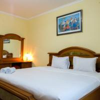 Classic Style 2BR At Redtop Apartment near Juanda By Travelio
