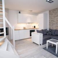 Dwupoziomowy apartament Mazowiecka 18