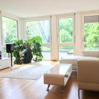 Central, riverside apartment with view