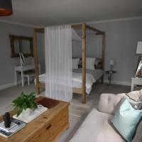 Ryefield Suite - luxurious guest room with four-poster bed and sumptuous bathroom