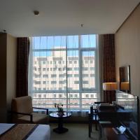 天津惠中酒店 Tianjin Elegance Hotel </h2 <div class=sr-card__item sr-card__item--badges <div class= sr-card__badge sr-card__badge--class u-margin:0  data-ga-track=click data-ga-category=SR Card Click data-ga-action=Hotel rating data-ga-label=book_window:  day(s)  <div class=china_stars_categories <i class= bk-icon-wrapper zhcn-ratings  title= <svg aria-hidden=true class=bk-icon -sprite-ratings_circles_4 focusable=false height=10 width=46<use xlink:href=#icon-sprite-ratings_circles_4</use</svg</i </div </div   <div style=padding: 2px 0    </div </div <div class=sr-card__item   data-ga-track=click data-ga-category=SR Card Click data-ga-action=Hotel location data-ga-label=book_window:  day(s)  <svg alt=Property location  class=bk-icon -iconset-geo_pin sr_svg__card_icon height=12 width=12<use xlink:href=#icon-iconset-geo_pin</use</svg <div class= sr-card__item__content   Tanggu, Binhai • <span 1.9 miles </span  from centre </div </div </div </div </a </li <div data-et-view=cJaQWPWNEQEDSVWe:1</div <li id=hotel_1797217 data-is-in-favourites=0 data-hotel-id='1797217' class=sr-card sr-card--arrow bui-card bui-u-bleed@small js-sr-card m_sr_info_icons card-halved card-halved--active   <a href=/hotel/cn/tianjin-ascott-teda-msd-service-apartment.en-gb.html target=_blank class=sr-card__row bui-card__content data-et-click=customGoal: aria-label=  Ascott TEDA MSD Tianjin,  Scored 9.4 ,      <div class=sr-card__image js-sr_simple_card_hotel_image has-debolded-deal js-lazy-image sr-card__image--lazy data-src=https://r-cf.bstatic.com/xdata/images/hotel/square200/69938361.jpg?k=c888999dec5133e69771de0a81a3b7aab555f782c30e01fde5c128ce885a834f&o=&s=1,https://q-cf.bstatic.com/xdata/images/hotel/max1024x768/69938361.jpg?k=f652ad328cf59bebc67047394c87a36d50ed80a8d5ca45064748b737da48f99b&o=&s=1  <div class=sr-card__image-inner css-loading-hidden </div <noscript <div class=sr-card__image--nojs style=background-image: url('https://r-cf.bstatic.com/xdata/images/hotel/square200/69938361.jpg?k=c888999