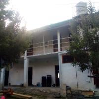 Om shanti house
