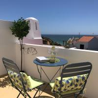 Tranquil Benagil apartment with sea views, pools and beach 200m