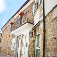 B&B La Pigna </h2 </a <div class=sr-card__item sr-card__item--badges <div style=padding: 2px 0    </div </div <div class=sr-card__item   data-ga-track=click data-ga-category=SR Card Click data-ga-action=Hotel location data-ga-label=book_window:  day(s)  <svg alt=Posizione della struttura class=bk-icon -iconset-geo_pin sr_svg__card_icon height=12 width=12<use xlink:href=#icon-iconset-geo_pin</use</svg <div class= sr-card__item__content   <strong class='sr-card__item--strong'Filiano</strong • a  <span 3,6 km </span  da Sant'Ilario </div </div </div </div </div </li <div data-et-view=cJaQWPWNEQEDSVWe:1</div <li id=hotel_5007157 data-is-in-favourites=0 data-hotel-id='5007157' class=sr-card sr-card--arrow bui-card bui-u-bleed@small js-sr-card m_sr_info_icons card-halved card-halved--active   <div data-href=/hotel/it/agriclub-il-cavallino.it.html onclick=window.open(this.getAttribute('data-href')); target=_blank class=sr-card__row bui-card__content data-et-click=  <div class=sr-card__image js-sr_simple_card_hotel_image has-debolded-deal js-lazy-image sr-card__image--lazy data-src=https://r-cf.bstatic.com/xdata/images/hotel/square200/196281931.jpg?k=4f247796710f213257df960c5f62c22af9568c71bede1013ce9caf62f6f5c959&o=&s=1,https://r-cf.bstatic.com/xdata/images/hotel/max1024x768/196281931.jpg?k=ebae0deb4e2276b4b364ece5219b819c51f1a5b155872809dd4adbfc630c3eed&o=&s=1  <div class=sr-card__image-inner css-loading-hidden </div <noscript <div class=sr-card__image--nojs style=background-image: url('https://r-cf.bstatic.com/xdata/images/hotel/square200/196281931.jpg?k=4f247796710f213257df960c5f62c22af9568c71bede1013ce9caf62f6f5c959&o=&s=1')</div </noscript </div <div class=sr-card__details data-et-click=     data-et-view=  <div class=sr-card_details__inner <a href=/hotel/it/agriclub-il-cavallino.it.html onclick=event.stopPropagation(); target=_blank <h2 class=sr-card__name u-margin:0 u-padding:0 data-ga-track=click data-ga-category=SR Card Click data-ga-action=Hotel name data-ga-label=book_window:  day(s)  Agriclub Il Cavallino </h2 </a <div class=sr-card__item sr-card__item--badges <div style=padding: 2px 0    </div </div <div class=sr-card__item   data-ga-track=click data-ga-category=SR Card Click data-ga-action=Hotel location data-ga-label=book_window:  day(s)  <svg alt=Posizione della struttura class=bk-icon -iconset-geo_pin sr_svg__card_icon height=12 width=12<use xlink:href=#icon-iconset-geo_pin</use</svg <div class= sr-card__item__content   <strong class='sr-card__item--strong'Filiano</strong • a  <span 3,5 km </span  da Sant'Ilario </div </div </div </div </div </li <div data-et-view=cJaQWPWNEQEDSVWe:1</div <li id=hotel_416708 data-is-in-favourites=0 data-hotel-id='416708' class=sr-card sr-card--arrow bui-card bui-u-bleed@small js-sr-card m_sr_info_icons card-halved card-halved--active   <div data-href=/hotel/it/portacastello-guesthouse.it.html onclick=window.open(this.getAttribute('data-href')); target=_blank class=sr-card__row bui-card__content data-et-click=  <div class=sr-card__image js-sr_simple_card_hotel_image has-debolded-deal js-lazy-image sr-card__image--lazy data-src=https://q-cf.bstatic.com/xdata/images/hotel/square200/111848456.jpg?k=af50bd3c88808a6a4819115b22294992f845a3d72255a2e9e5f28c38b00a457b&o=&s=1,https://r-cf.bstatic.com/xdata/images/hotel/max1024x768/111848456.jpg?k=ce94f7d5e154101779a9e22cf85238e54e36ce1052294ba5558f06a725d4bf2e&o=&s=1  <div class=sr-card__image-inner css-loading-hidden </div <noscript <div class=sr-card__image--nojs style=background-image: url('https://q-cf.bstatic.com/xdata/images/hotel/square200/111848456.jpg?k=af50bd3c88808a6a4819115b22294992f845a3d72255a2e9e5f28c38b00a457b&o=&s=1')</div </noscript </div <div class=sr-card__details data-et-click=     data-et-view=  <div class=sr-card_details__inner <a href=/hotel/it/portacastello-guesthouse.it.html onclick=event.stopPropagation(); target=_blank <h2 class=sr-card__name u-margin:0 u-padding:0 data-ga-track=click data-ga-category=SR Card Click data-ga-action=Hotel name data-ga-label=book_window:  day(s)  AffittaCamere Portacastello </h2 </a <div class=sr-card__item sr-card__item--badges <div style=padding: 2px 0  <div class=bui-review-score c-score bui-review-score--smaller <div class=bui-review-score__badge aria-label=Punteggio di 9,7 9,7 </div <div class=bui-review-score__content <div class=bui-review-score__title Eccezionale </div </div </div   </div </div <div class=sr-card__item   data-ga-track=click data-ga-category=SR Card Click data-ga-action=Hotel location data-ga-label=book_window:  day(s)  <svg alt=Posizione della struttura class=bk-icon -iconset-geo_pin sr_svg__card_icon height=12 width=12<use xlink:href=#icon-iconset-geo_pin</use</svg <div class= sr-card__item__content   <strong class='sr-card__item--strong'Castel Lagopesole</strong • a  <span 5 km </span  da Sant'Ilario </div </div </div </div </div </li <div data-et-view=cJaQWPWNEQEDSVWe:1</div <li id=hotel_2616032 data-is-in-favourites=0 data-hotel-id='2616032' class=sr-card sr-card--arrow bui-card bui-u-bleed@small js-sr-card m_sr_info_icons card-halved card-halved--active   <div data-href=/hotel/it/residenza-manfredi.it.html onclick=window.open(this.getAttribute('data-href')); target=_blank class=sr-card__row bui-card__content data-et-click=  <div class=sr-card__image js-sr_simple_card_hotel_image has-debolded-deal js-lazy-image sr-card__image--lazy data-src=https://r-cf.bstatic.com/xdata/images/hotel/square200/110088200.jpg?k=a209c94f79c362bc2df676de51b6914804fa2fd0297d57046ebb9583fc5ad072&o=&s=1,https://r-cf.bstatic.com/xdata/images/hotel/max1024x768/110088200.jpg?k=5632a34e4b2c2e92e1f6b7f1940a3cf934ce644df53c1bcd801811dc296c5a2c&o=&s=1  <div class=sr-card__image-inner css-loading-hidden </div <noscript <div class=sr-card__image--nojs style=background-image: url('https://r-cf.bstatic.com/xdata/images/hotel/square200/110088200.jpg?k=a209c94f79c362bc2df676de51b6914804fa2fd0297d57046ebb9583fc5ad072&o=&s=1')</div </noscript </div <div class=sr-card__details data-et-click=     data-et-view=  <div class=sr-card_details__inner <a href=/hotel/it/residenza-manfredi.it.html onclick=event.stopPropagation(); target=_blank <h2 class=sr-card__name u-margin:0 u-padding:0 data-ga-track=click data-ga-category=SR Card Click data-ga-action=Hotel name data-ga-label=book_window:  day(s)  Residenza Manfredi </h2 </a <div class=sr-card__item sr-card__item--badges <div class= sr-card__badge sr-card__badge--class u-margin:0  data-ga-track=click data-ga-category=SR Card Click data-ga-action=Hotel rating data-ga-label=book_window:  day(s)  <span class=bh-quality-bars bh-quality-bars--small   <svg class=bk-icon -iconset-square_rating fill=#FEBB02 height=12 width=12<use xlink:href=#icon-iconset-square_rating</use</svg<svg class=bk-icon -iconset-square_rating fill=#FEBB02 height=12 width=12<use xlink:href=#icon-iconset-square_rating</use</svg<svg class=bk-icon -iconset-square_rating fill=#FEBB02 height=12 width=12<use xlink:href=#icon-iconset-square_rating</use</svg </span </div   <div style=padding: 2px 0  <div class=bui-review-score c-score bui-review-score--smaller <div class=bui-review-score__badge aria-label=Punteggio di 8,7 8,7 </div <div class=bui-review-score__content <div class=bui-review-score__title Favoloso </div </div </div   </div </div <div class=sr-card__item   data-ga-track=click data-ga-category=SR Card Click data-ga-action=Hotel location data-ga-label=book_window:  day(s)  <svg alt=Posizione della struttura class=bk-icon -iconset-geo_pin sr_svg__card_icon height=12 width=12<use xlink:href=#icon-iconset-geo_pin</use</svg <div class= sr-card__item__content   <strong class='sr-card__item--strong'Castel Lagopesole</strong • a  <span 5 km </span  da Sant'Ilario </div </div </div </div </div </li <li class=bui-card bui-u-bleed@small bh-quality-sr-explanation-card <div class=bh-quality-sr-explanation <span class=bh-quality-bars bh-quality-bars--small   <svg class=bk-icon -iconset-square_rating fill=#FEBB02 height=12 width=12<use xlink:href=#icon-iconset-square_rating</use</svg<svg class=bk-icon -iconset-square_rating fill=#FEBB02 height=12 width=12<use xlink:href=#icon-iconset-square_rating</use</svg<svg class=bk-icon -iconset-square_rating fill=#FEBB02 height=12 width=12<use xlink:href=#icon-iconset-square_rating</use</svg </span Una nuova valutazione della qualità da Booking.com per alloggi come case e appartamenti. <button type=button class=bui-link bui-link--primary aria-label=Open Modal data-modal-id=bh_quality_learn_more data-bui-component=Modal <span class=bui-button__textScopri di più</span </button </div <template id=bh_quality_learn_more <header class=bui-modal__header <h1 class=bui-modal__title id=myModal-title data-bui-ref=modal-title Valutazione della qualità </h1 </header <div class=bui-modal__body bui-modal__body--primary bh-quality-modal <h3 class=bh-quality-modal__heading <span class=bh-quality-bars bh-quality-bars--small   <svg class=bk-icon -iconset-square_rating fill=#FEBB02 height=12 width=12<use xlink:href=#icon-iconset-square_rating</use</svg<svg class=bk-icon -iconset-square_rating fill=#FEBB02 height=12 width=12<use xlink:href=#icon-iconset-square_rating</use</svg<svg class=bk-icon -iconset-square_rating fill=#FEBB02 height=12 width=12<use xlink:href=#icon-iconset-square_rating</use</svg<svg class=bk-icon -iconset-square_rating fill=#FEBB02 height=12 width=12<use xlink:href=#icon-iconset-square_rating</use</svg<svg class=bk-icon -iconset-square_rating fill=#FEBB02 height=12 width=12<use xlink:href=#icon-iconset-square_rating</use</svg </span