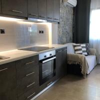 Ground floor apartment with stone decorated walls
