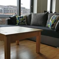 City Centre apartment with balcony and striking views. Five min from train station
