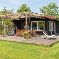 Three-Bedroom Holiday Home in Holbak