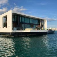 ARKUP · Stay at a luxury Overwater Villa in South Beach