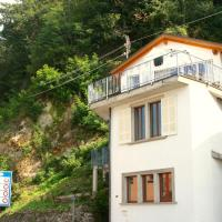 Holiday home in a wonderful location on Lake Lugano with a view.
