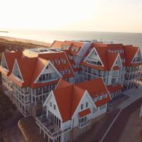 Familie beachhuis op de duinen (Duinhuis)
