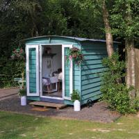 Luxury Shepherds Huts set in an idyllic location on the Kent Sussex border -all mod cons