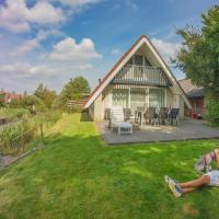 Sonnenhaus 6 pers house with sunny terrace at a typical dutch canal & by Lauwersmeer lake.