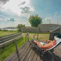 4 pers Mia Holiday home with lake view in front of the Lauwersmeer