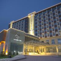 Safa Sorgun Thermal Hotel </h2 </a <div class=sr-card__item sr-card__item--badges <div class= sr-card__badge sr-card__badge--class u-margin:0  data-ga-track=click data-ga-category=SR Card Click data-ga-action=Hotel rating data-ga-label=book_window:  day(s)  <i class= bk-icon-wrapper bk-icon-stars star_track  title=5 stars  <svg aria-hidden=true class=bk-icon -sprite-ratings_stars_5 focusable=false height=10 width=54<use xlink:href=#icon-sprite-ratings_stars_5</use</svg                     <span class=invisible_spoken5 stars</span </i </div   <div style=padding: 2px 0  <div class=bui-review-score c-score bui-review-score--smaller <div class=bui-review-score__badge aria-label=Scored 8.5  8.5 </div <div class=bui-review-score__content <div class=bui-review-score__title Very good </div </div </div   </div </div <div class=sr-card__item   data-ga-track=click data-ga-category=SR Card Click data-ga-action=Hotel location data-ga-label=book_window:  day(s)  <svg alt=Property location  class=bk-icon -iconset-geo_pin sr_svg__card_icon height=12 width=12<use xlink:href=#icon-iconset-geo_pin</use</svg <div class= sr-card__item__content   Sorgun • <span 1.3 miles </span  from centre </div </div </div </div </div </li <div data-et-view=customGoal:GbQUJWPHDDHUWDIbNCMKPaAUaJbNWJKDKaT:1</div </ol </div </div <div data-block=pagination </div <script if( window.performance && performance.measure && 'b-fold') { performance.measure('b-fold'); } </script  <script (function () { if (typeof EventTarget !== 'undefined') { if (typeof EventTarget.prototype.dispatchEvent === 'undefined' && typeof EventTarget.prototype.fireEvent === 'function') { EventTarget.prototype.dispatchEvent = EventTarget.prototype.fireEvent; } } if (typeof window.CustomEvent !== 'function') { // Mobile IE has CustomEvent implemented as Object, this fixes it. var CustomEvent = function(event, params) { // don't delete var evt; params = params || {bubbles: false, cancelable: false, detail: undefined}; try { evt = document.createEvent('CustomEvent'); evt.initCustomEvent(event, params.bubbles, params.cancelable, params.detail); } catch (error) { // fallback for browsers that don't support createEvent('CustomEvent') evt = document.createEvent(Event); for (var param in params) { evt[param] = params[param]; } evt.initEvent(event, params.bubbles, params.cancelable); } return evt; }; CustomEvent.prototype = window.Event.prototype; window.CustomEvent = CustomEvent; } if (!Element.prototype.matches) { Element.prototype.matches = Element.prototype.matchesSelector || Element.prototype.msMatchesSelector || Element.prototype.oMatchesSelector || Element.prototype.webkitMatchesSelector; } if (!Element.prototype.closest) { Element.prototype.closest = function(s) { var el = this; if (!document.documentElement.contains(el)) return null; do { if (el.matches(s)) return el; el = el.parentElement || el.parentNode; } while (el !== null && el.nodeType === 1); return null; }; } }()); (function(){ var searchboxEl = document.querySelector('.js-searchbox_redesign'); if (!searchboxEl) return; var groupChildren = searchboxEl.querySelector('[name=group_children]'); var childAgesEl = searchboxEl.querySelector('.js-child-ages'); var childAgesLabelEl = searchboxEl.querySelector('.js-child-ages-label'); var ageOptionHTML; var childrenNo; function showChildrenAges() { childAgesEl.style.display = 'block'; childAgesLabelEl.style.display = 'block'; } function hideChildrenAges() { childAgesEl.style.display = 'none'; childAgesLabelEl.style.display = 'none'; } function onGroupChildenChange(e) { var newValue = parseInt(e.target.value); if (newValue  childrenNo) { for (var i = newValue; i  childrenNo; i--) { childAgesEl.insertAdjacentHTML('beforeend', ageOptionHTML); } } else { var els = childAgesEl.querySelectorAll('.js-age-option-container'); for (var i = els.length - 1; i = 0; i--) { if (i = newValue) { var el = els[i]; if (el.parentNode !== null) { el.parentNode.removeChild(el); } } } } if (newValue == 0 && childrenNo  0) { hideChildrenAges(); } if (newValue  0 && childrenNo == 0) { showChildrenAges(); } childrenNo = newValue; } if (groupChildren) { groupChildren.disabled = false; childrenNo = parseInt(groupChildren.value); if (childrenNo  0) { showChildrenAges(); } ageOptionHTML = document.querySelector('#sb-age-option-container').innerHTML; groupChildren.addEventListener('change', onGroupChildenChange); document.addEventListener('cp:sb-group-children-ready', function() { groupChildren.removeEventListener('change', onGroupChildenChange); }); } }()); </script <div class=css-loading-hidden m_lp_below_fold_container <div id=sr_nearby_destinations data-component=sr_lazy_load_nearby_destinations </div </div </div </div <div class= tabbed-nav--content tabbed-nav--content__search tabbed-nav--content__search-with-tabs  data-tab-id=search id=tabbed_search  <div class= sb__tabs js-sb__tabs <div class= sb__tabs__item js-sb__tabs__item active data-id=sb_hotels  <form id=form_search_location class=js-searchbox_redesign searchbox_redesign searchbox_redesign--iphone searchForm searchbox_fullwidth placeholder_clear b-no-tap-highlight name=frm action=/searchresults.en-gb.html method=get data-component=searchbox/destination/near-me  <input type=hidden value=searchresults name=src <input type=hidden name=rows value=20 / <input type=hidden name=error_url value=https://www.booking.com/index.en-gb.html; / <input type=hidden name=label value=gen000nr-10CAQoggJCDGNpdHlfLTc3MTQ5MkgJWARoUIgBApgBM7gBBcgBDdgBA-gBAfgBAYgCAagCAbgCvJee7AXAAgE / <input type=hidden name=sb value=1 <div class=destination-bar <div id=searchbox_tab <div id=input_destination_wrap <input type=hidden name=city value=-771492 / <input type=hidden name=ssne value=Sorgun / <input type=hidden name=ssne_untouched value=Sorgun / <div class=searchbox_input_with_suggestion ui-autocomplete-root <div class=dest-input--with-icons <svg aria-hidden=true class=bk-icon -fonticon-search bk-icon--search sr-svg--header_icon_search focusable=false height=14 width=15<use xlink:href=#icon-fonticon-search</use</svg <input type=search id=input_destination name=ss spellcheck=false autocapitalize=off autocorrect=off autocomplete=off class= input_destination js-input_dest has_placeholder input_clear_button_input aria-label=Insert your destination here value=Sorgun  <button class=input_clear_button type=button  <svg class=bk-icon -fonticon-aclose bk-icon--aclose sr-svg--header_icon_aclose height=12 width=14<use xlink:href=#icon-fonticon-aclose</use</svg </button </div </div </div <div id=location_loading style=display: none  class= <img id=loading_icon src=https://r-cf.bstatic.com/mobile/images/hotelMarkerImgLoader/211f81a092a43bf96fc2a7b1dff37e5bc08fbbbf.gif alt=Loading your location / Loading current location </div <div id=location_found style=display: none  <div id=location_found_text Around current location </div </div </div </div <fieldset class= searchbox_cals dualcal searchbox_cals_nojs  data-checkin= data-checkout=  <script type=text/html class=js-cal-inputs <input type=hidden name=checkin_monthday value=22 / <input type=hidden name=checkin_year_month value=2019-9 / <input type=hidden name=checkout_monthday value=23 / <input type=hidden name=checkout_year_month value=2019-9 / </script <div class=searchbox_cals_container <div id=ci_date class= bar b-no-tap-highlight js-searchbox__input dualcal__checkin  data-action=toggle data-clicked-before-ready=0 data-cal=checkin  <div class=bar--container <label class=dual_cal_label Check-in date </label <div id=ci_date_field <span id=ci_date_text class=m_cal_date_string js-loading-invisible data-checkin-text Sun 22 Sept 2019 </span </div <svg class=bk-icon -fonticon-checkin searchbox-icon fill=currentColor height=24 width=24<use xlink:href=#icon-fonticon-checkin</use</svg </div <div id=searchBoxLoaderDateCheckIn class=searchbox-before-ready-loading <div class=pure-css-spinner</div </div <select name=checkin_monthday class=js-cal-nojs-input  <option value=Day</option <option value=1 1</option <option value=2 2</option <option value=3 3</option <option value=4 4</option <option value=5 5</option <option value=6 6</option <option value=7 7</option <option value=8 8</option <option value=9 9</option <option value=10 10</option <option value=11 11</option <option value=12 12</option <option value=13 13</option <option value=14 14</option <option value=15 15</option <option value=16 16</option <option value=17 17</option <option value=18 18</option <option value=19 19</option <option value=20 20</option <option value=21 21</option <option value=22 selected=selected 22</option <option value=23 23</option <option value=24 24</option <option value=25 25</option <option value=26 26</option <option value=27 27</option <option value=28 28</option <option value=29 29</option <option value=30 30</option <option value=31 31</option </select <select name=checkin_year_month class=js-cal-nojs-input  <option value=Month</option <option value=2019-9 selected=selected  September 2019 </option <option value=2019-10  October 2019 </option <option value=2019-11  November 2019 </option <option value=2019-12  December 2019 </option <option value=2020-1  January 2020 </option <option value=2020-2  February 2020 </option <option value=2020-3  March 2020 </option <option value=2020-4  April 2020 </option <option value=2020-5  May 2020 </option <option value=2020-6  June 2020 </option <option value=2020-7  July 2020 </option <option value=2020-8  August 2020 </option <option value=2020-9  September 2020 </option </select <input type=hidden disabled id=ci_date_input name=checkin value=2019-09-22 / </div <div id=co_date class= bar b-no-tap-highlight js-searchbox__input dualcal__checkout  data-action=toggle data-clicked-before-ready=0 data-cal=checkout  <div class=bar--container <label class=dual_cal_label Check-out date </label <div id=co_date_field <span id=co_date_text class=m_cal_date_string js-loading-invisible data-checkout-text Mon 23 Sept 2019 </span </div <svg class=bk-icon -fonticon-checkin searchbox-icon fill=currentColor height=24 width=24<use xlink:href=#icon-fonticon-checkin</use</svg <div id=searchBoxLoaderDateCheckOut class=searchbox-before-ready-loading <div class=pure-css-spinner</div </div </div <select name=checkout_monthday class=js-cal-nojs-input  <option value=Day</option <option value=1 1</option <option value=2 2</option <option value=3 3</option <option value=4 4</option <option value=5 5</option <option value=6 6</option <option value=7 7</option <option value=8 8</option <option value=9 9</option <option value=10 10</option <option value=11 11</option <option value=12 12</option <option value=13 13</option <option value=14 14</option <option value=15 15</option <option value=16 16</option <option value=17 17</option <option value=18 18</option <option value=19 19</option <option value=20 20</option <option value=21 21</option <option value=22 22</option <option value=23 selected=selected 23</option <option value=24 24</option <option value=25 25</option <option value=26 26</option <option value=27 27</option <option value=28 28</option <option value=29 29</option <option value=30 30</option <option value=31 31</option </select <select name=checkout_year_month class=js-cal-nojs-input  <option value=Month</option <option value=2019-9 selected=selected  September 2019 </option <option value=2019-10  October 2019 </option <option value=2019-11  November 2019 </option <option value=2019-12  December 2019 </option <option value=2020-1  January 2020 </option <option value=2020-2  February 2020 </option <option value=2020-3  March 2020 </option <option value=2020-4  April 2020 </option <option value=2020-5  May 2020 </option <option value=2020-6  June 2020 </option <option value=2020-7  July 2020 </option <option value=2020-8  August 2020 </option <option value=2020-9  September 2020 </option </select <input type=hidden id=co_date_input disabled name=checkout value=2019-09-23 / </div </div <div class=dualcal-pikaday pikaday-checkin checkInCal css-loading-hidden pikaday-highlighted-weekends  </div <div class=dualcal-pikaday pikaday-checkout checkOutCal css-loading-hidden pikaday-highlighted-weekends  </div </fieldset <input class=js-first-room-param-setup type=hidden name=room1 value=A,A disabled / <input class=pageshow-anchor type=hidden autocomplete=on value= <fieldset class=group_search group_options js-searchbox__input b-no-tap-highlight  <label class=group_options_label   <span class=group_options_label--text Adults</span <select class=group_adults name=group_adults  <optgroup <option value=11</option <option value=2 selected=selected2</option <option value=33</option <option value=44</option <option value=55</option <option value=66</option <option value=77</option <option value=88</option <option value=99</option <option value=1010</option <option value=1111</option <option value=1212</option <option value=1313</option <option value=1414</option <option value=1515</option <option value=1616</option <option value=1717</option <option value=1818</option <option value=1919</option <option value=2020</option <option value=2121</option <option value=2222</option <option value=2323</option <option value=2424</option <option value=2525</option <option value=2626</option <option value=2727</option <option value=2828</option <option value=2929</option <option value=3030</option </optgroup </select </label <label class=group_options_label <span class=group_options_label--text Children </span <select name=group_children class=group_children  <optgroup <option value=0 selected=selected0</option <option value=11</option <option value=22</option <option value=33</option <option value=44</option <option value=55</option <option value=66</option <option value=77</option <option value=88</option <option value=99</option <option value=1010</option </optgroup </select </label <label class=group_options_label js-sr-rooms-selector group_options_label_last<span class=group_options_label--textRooms</span<select class=group_rooms name=no_rooms<optgroup<option  value=11</option<option  value=22</option<option  value=33</option<option  value=44</option<option  value=55</option<option  value=66</option<option  value=77</option<option  value=88</option<option  value=99</option<option  value=1010</option<option  value=1111</option<option  value=1212</option<option  value=1313</option<option  value=1414</option<option  value=1515</option<option  value=1616</option<option  value=1717</option<option  value=1818</option<option  value=1919</option<option  value=2020</option<option  value=2121</option<option  value=2222</option<option  value=2323</option<option  value=2424</option<option  value=2525</option<option  value=2626</option<option  value=2727</option<option  value=2828</option<option  value=2929</option<option  value=3030</option</optgroup</select</label <label class=child_ages_label js-child-ages-label Ages of children at check-out </label <div class=clx child_ages js-child-ages </div </fieldset <input type=hidden name=search_form_id value=e19b691e60860352 <fieldset class=searchbox_purpose searchbox_purpose__radios data-component=searchbox/travel-purpose/hint <div class=searchbox--radio-group <div class=searchbox--radio-group--label js-travel-purpose-label <span class=searchbox--radio-group--text Are you travelling for work? </span <svg class=bk-icon -fonticon-questionmarkcircle searchbox--radio-group--hintmark css-loading-hidden height=16 width=16<use xlink:href=#icon-fonticon-questionmarkcircle</use</svg </div <div class=searchbox--radio-group--hintbox css-loading-hidden <span class=searchbox--radio-group--hintbox-text If you're travelling for work, we'll sort the most popular business travel features to the top of the filter menu so you can find them quickly. </span </div <label class=searchbox--radio-group--item searchbox--radio-group--item__business <input name=sb_travel_purpose type=radio class=searchbox--radio-group--input value=business  <span class=searchbox--radio-group--text Yes </span </label <label class=searchbox--radio-group--item searchbox--radio-group--item__leisure <input name=sb_travel_purpose type=radio class=searchbox--radio-group--input value=leisure  <span class=searchbox--radio-group--text No </span </label </div </fieldset <button id=submit_search class=primary_cta js_submit_search js-searchbox__input b-no-tap-highlight m_bigger_search_button type=submit title=Search hotels Search </button </form <template id=sb-age-option-container <div class=age_option-container  js-age-option-container <select name=age class=age <optgroup <option value=0 selected  0 </option <option value=1  1 </option <option value=2  2 </option <option value=3  3 </option <option value=4  4 </option <option value=5  5 </option <option value=6  6 </option <option value=7  7 </option <option value=8  8 </option <option value=9  9 </option <option value=10  10 </option <option value=11  11 </option <option value=12  12 </option <option value=13  13 </option <option value=14  14 </option <option value=15  15 </option <option value=16  16 </option <option value=17  17 </option </optgroup </select </div </template </div </div <a class=iam-banner-link href=https://account.booking.com/auth/oauth2?redirect_uri=https%3A%2F%2Fsecure.booking.com%2Flogin.html%3Fop%3Doauth_return&aid=304142&lang=en-gb&state=UvYBiO465KAJJk4LMSBRhfxIRkUnUvJRz0oIQ9mgnjaMOJSMJ1etPSkJFQI9Qg10ul9vSRWD-07pRcuw2YakG-0aiiUxX8jf3WkvvSIADLWMlWdEvm9a1FDHQKYZNKhQiSnndEmhOwExaTXlPhgO_YnMItaudFT57zBskUkuEVwJVv8THkn_T1k3xQh6YpnGoAWntw4AbGLHXQTWCqIYIDt9wwYF-rtS2vgjUfh3opAMNwv7HjnWENhXpXlqwyt0Bs10FIN4svfKJ9hPUGrxqJc0I2NdUh337agr4R_IWb58cJHaBuf1Frxtj4xMhX0XNJe3RJP4RVlE&client_id=vO1Kblk7xX9tUn2cpZLS&dt=1569164221&response_type=code aria-describedby=signin_banner_desc_01 <div class=bui-container <div class=bui-card bui-banner bui-u-bleed@small <svg class=bk-icon -iconset-user_account_outline bui-banner__icon height=24 role=presentation width=24<use xlink:href=#icon-iconset-user_account_outline</use</svg <div class=bui-banner__content <header class=bui-card__header <h1 class=bui-card__titleSign in to save more!</h1 <h2 class=bui-card__subtitle id=signin_banner_desc_01Sign in to unlock our best prices</h2 </header </div </div </div </a <div class=tabbed-nav--content__search--usps </div </div <div class=tabbed-nav--content tabbed-nav--content__signin data-tab-id=signin data-async-content id=tabbed_signin <div class=tabbed-nav--loader</div <div class=async-signin-retry async-signin-retry__hidden <h3 class=async-signin-retry__headingSomething went wrong. <brPlease try again