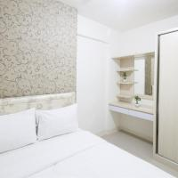 2BR Green Pramuka City Apartment by Travelio