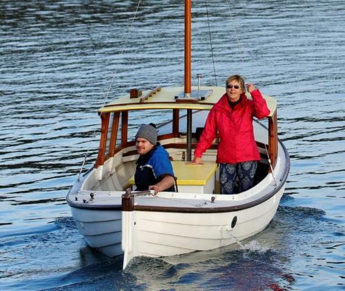 Raylene taking ownership of her new boat, Else, Hayden Johnson at tiller