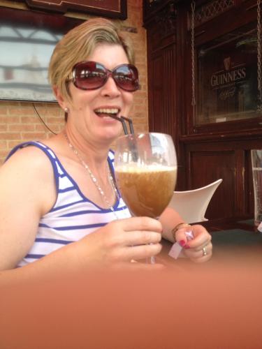 Host enjoying an Irish coffee